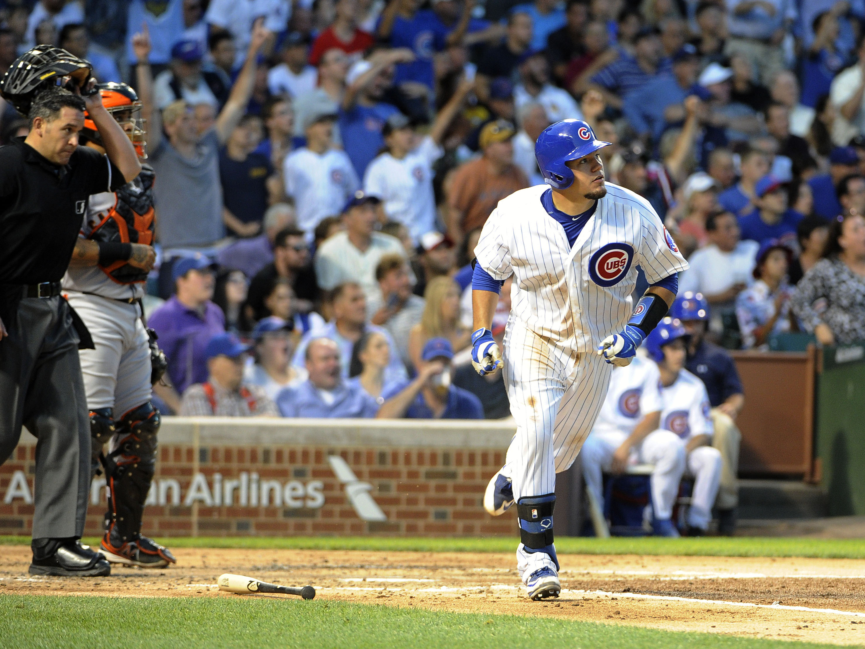 Chicago Cubs' Kyle Schwarber watches his three-run home run against the San Francisco Giants during the second inning of a baseball game, Thursday, Aug. 6, 2015, in Chicago. (AP Photo/David Banks)