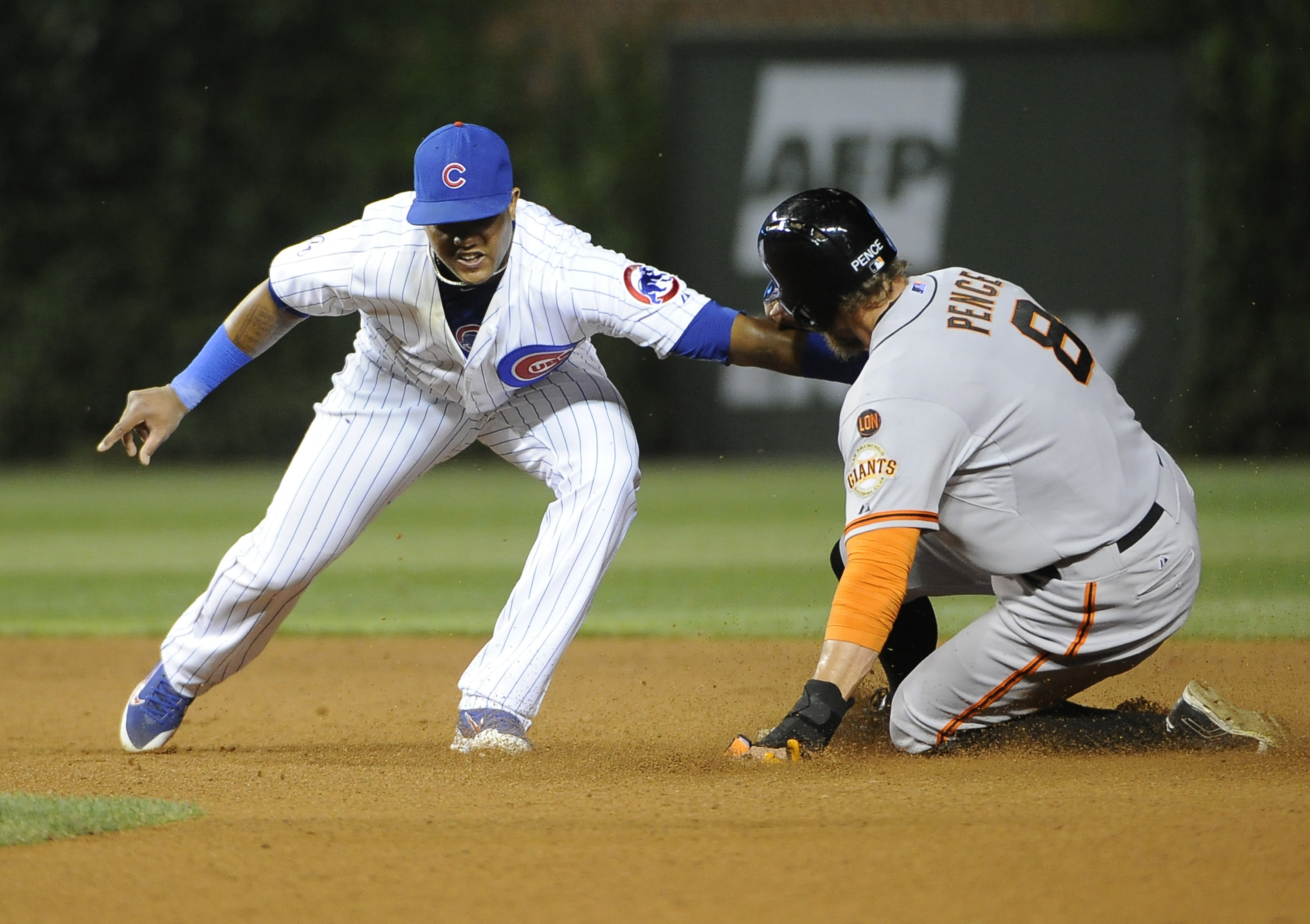 San Francisco Giants' Hunter Pence (8) steals second base as Chicago Cubs shortstop Starlin Castro, left, makes a late tag during the sixth inning of a baseball game, Thursday, Aug. 6, 2015, in Chicago. (AP Photo/David Banks)