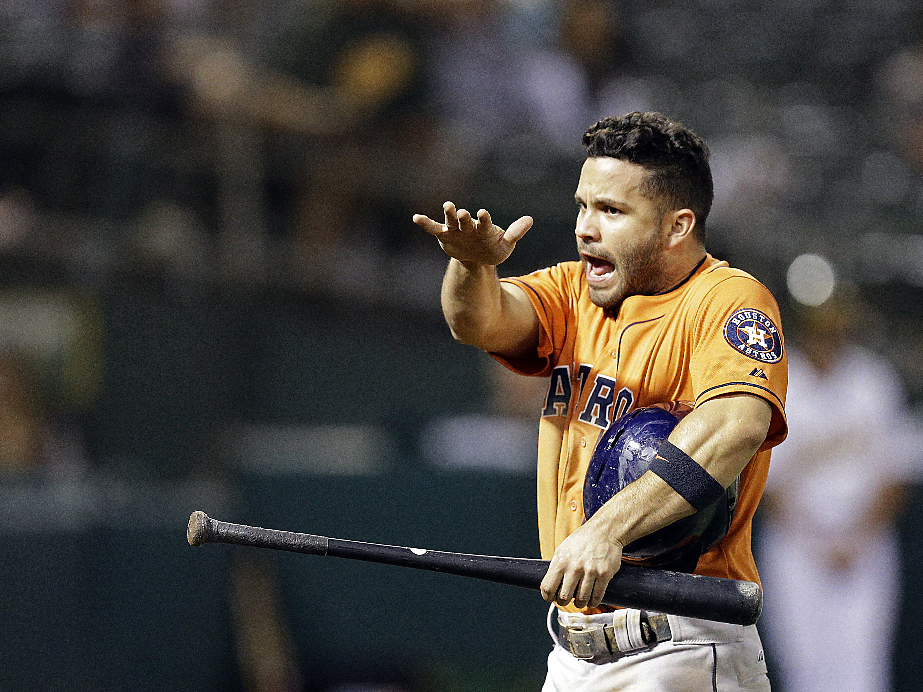 Houston Astros' Jose Altuve celebrates after scoring against the Oakland Athletics in the tenth inning of a baseball game Thursday, Aug. 6, 2015, in Oakland, Calif. (AP Photo/Ben Margot)
