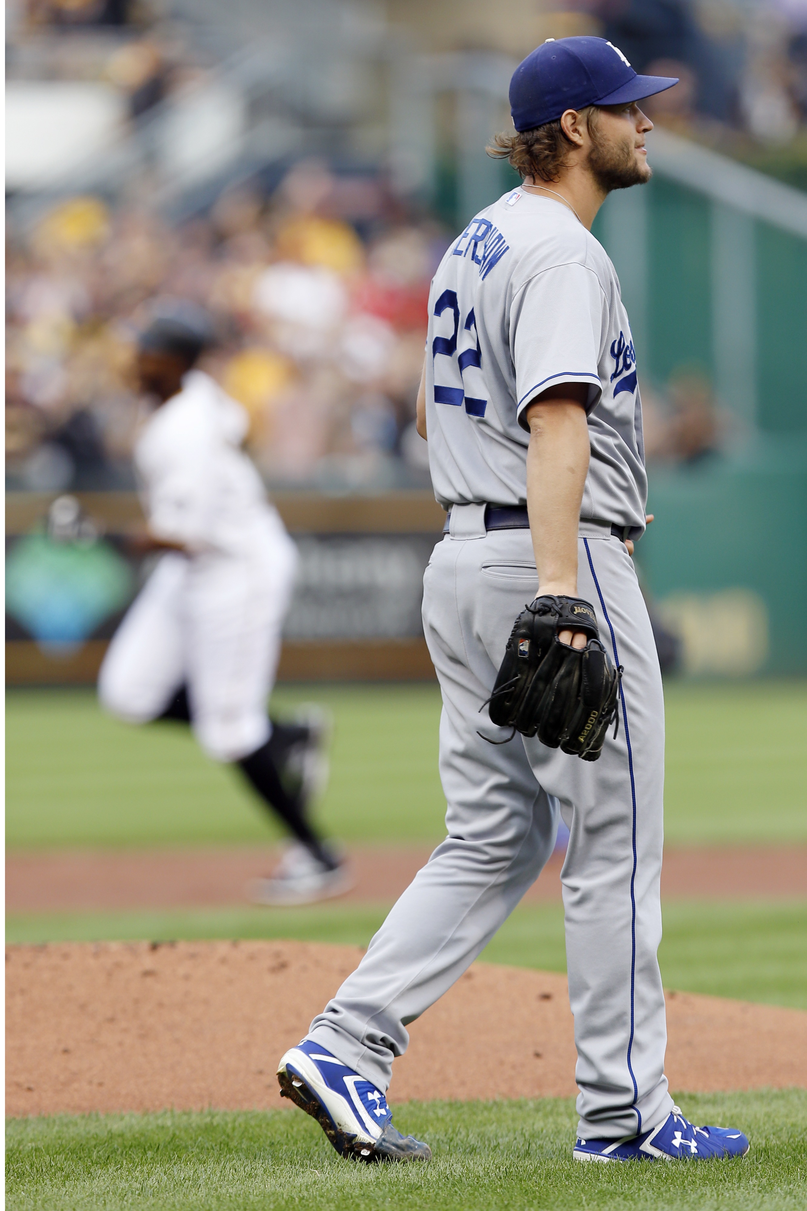 Los Angeles Dodgers starting pitcher Clayton Kershaw, right, looks toward left field as Pittsburgh Pirates' Gregory Polanco rounds the bases after hitting a solo home run in the first inning of a baseball game, Friday, Aug. 7, 2015, in Pittsburgh. (AP Pho