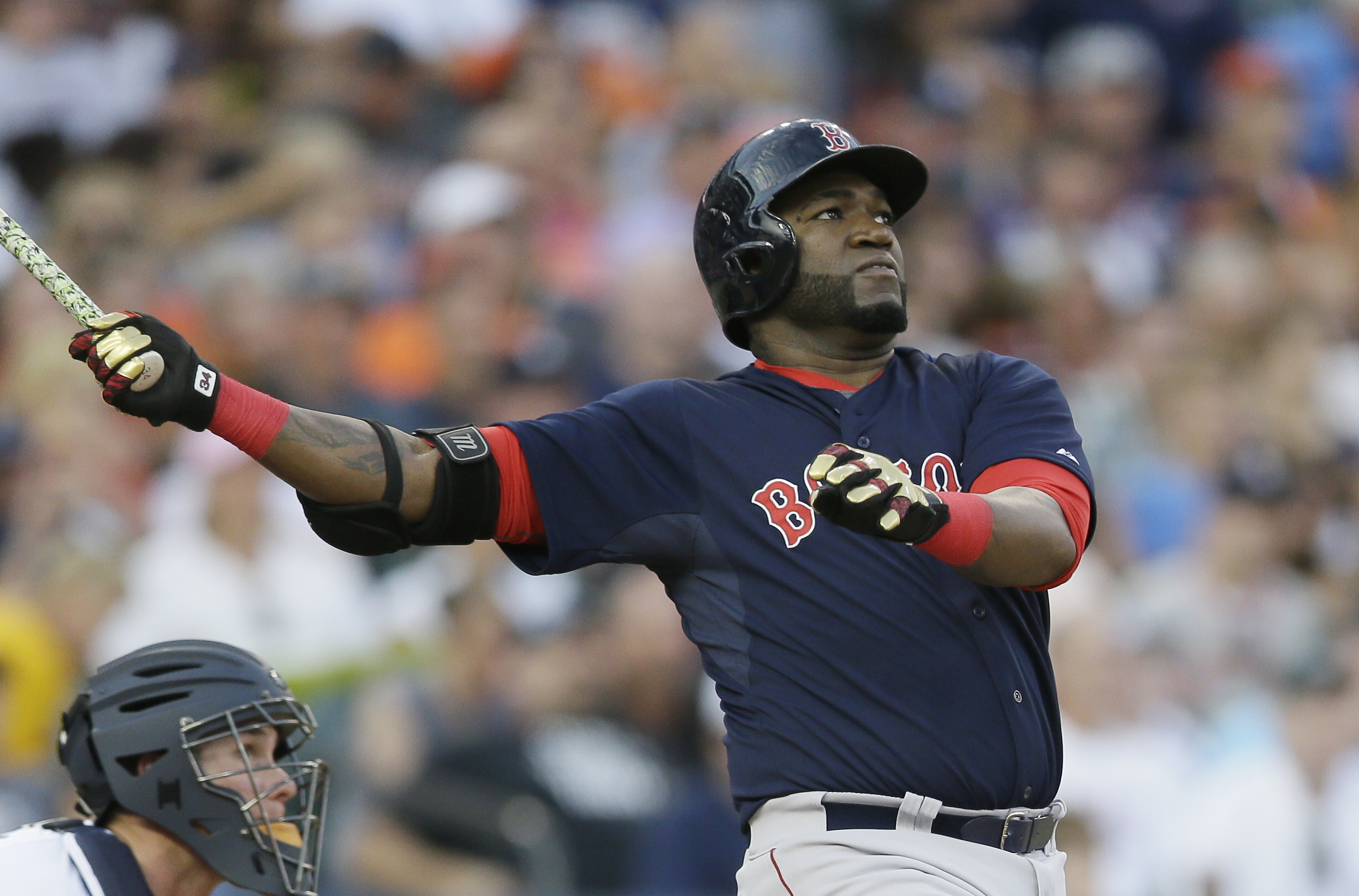 Boston Red Sox designated hitter David Ortiz follows through on his two-run home run off Detroit Tigers starting pitcher Daniel Norris during the third inning of a baseball game, Friday, Aug. 7, 2015, in Detroit. (AP Photo/Carlos Osorio)