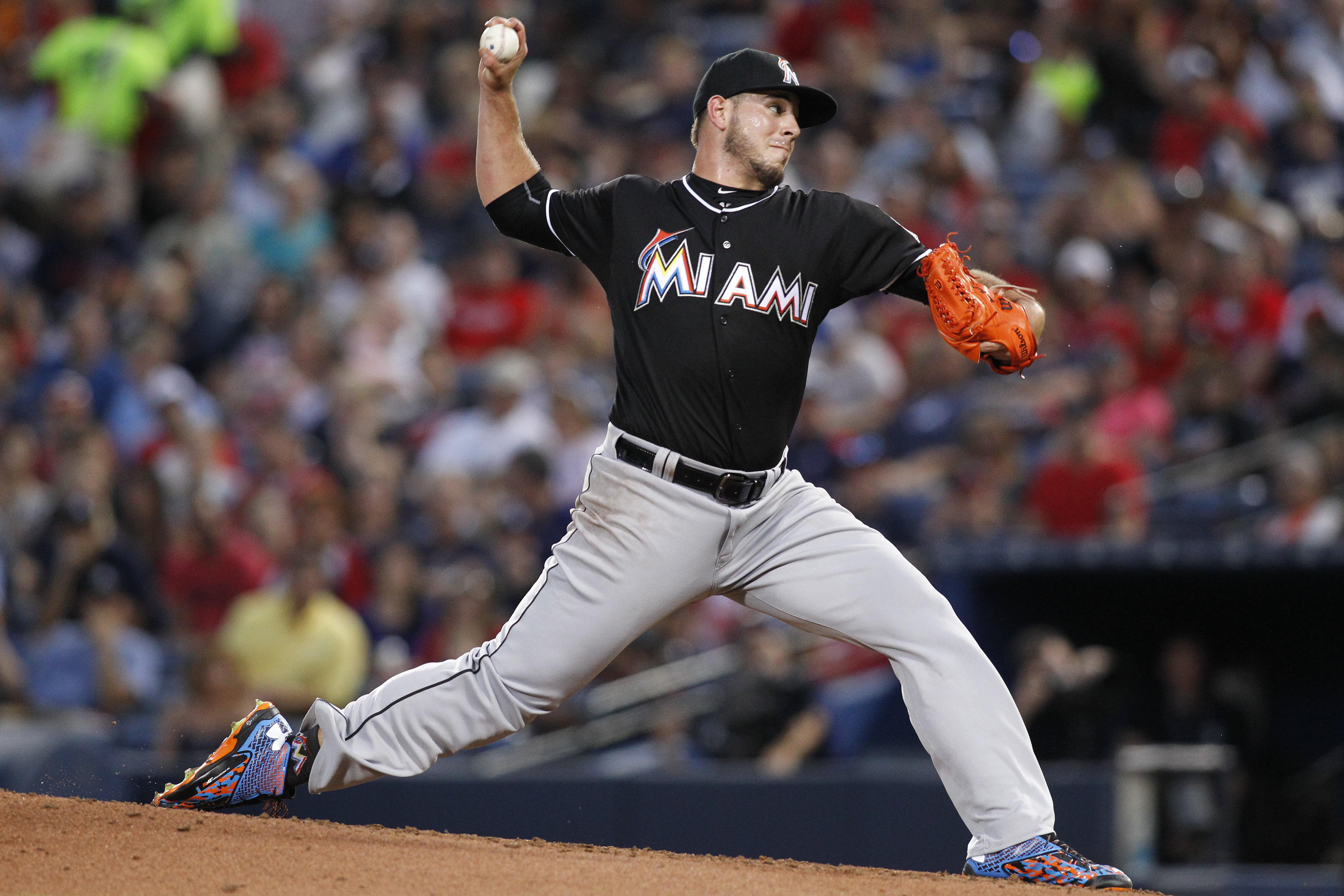Miami Marlins starting pitcher Jose Fernandez throws during the fourth inning of a baseball game against the Atlanta Braves, Friday, Aug. 7, 2015, in Atlanta. (AP Photo/Brett Davis)