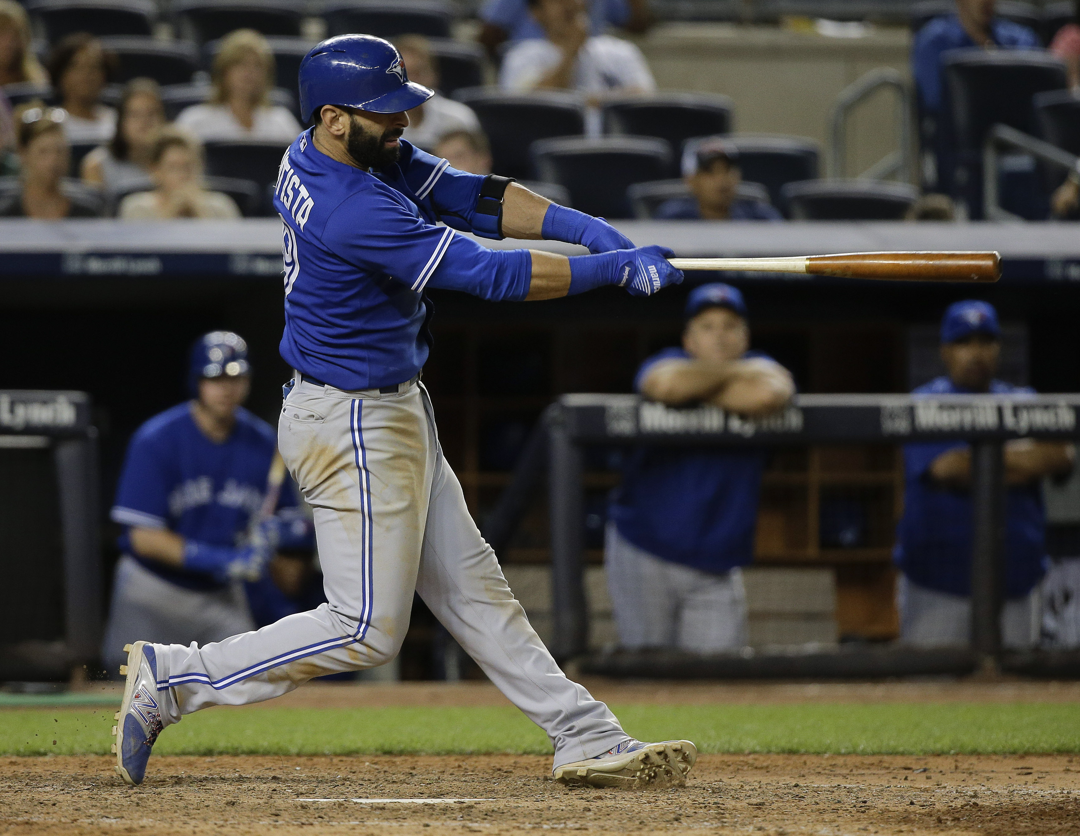 Toronto Blue Jays right fielder Jose Bautista follows through on a home run during the 10th inning of a baseball game against the New York Yankees, Friday, Aug. 7, 2015, in New York. The Blue Jays won 2-1 in 10 innings. (AP Photo/Julie Jacobson)