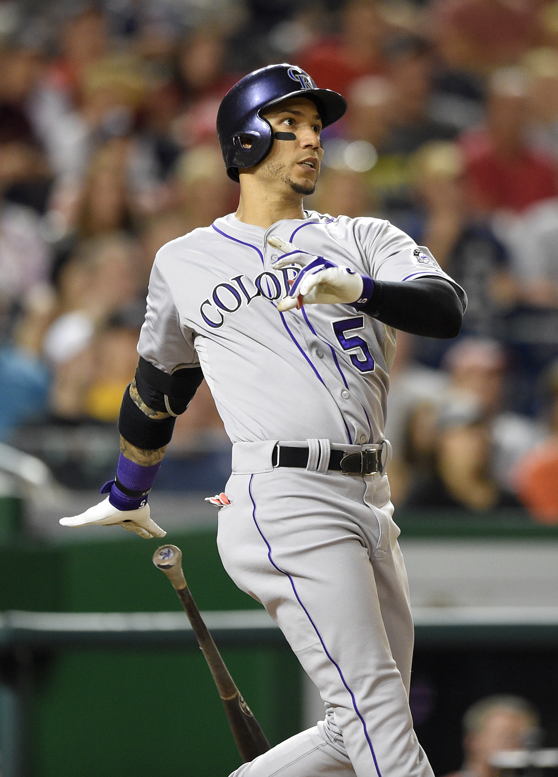 Colorado Rockies' Carlos Gonzalez watches his grand slam during the eighth inning of a baseball game against the Washington Nationals, Friday, Aug. 7, 2015, in Washington. The Rockies won 5-4. (AP Photo/Nick Wass)