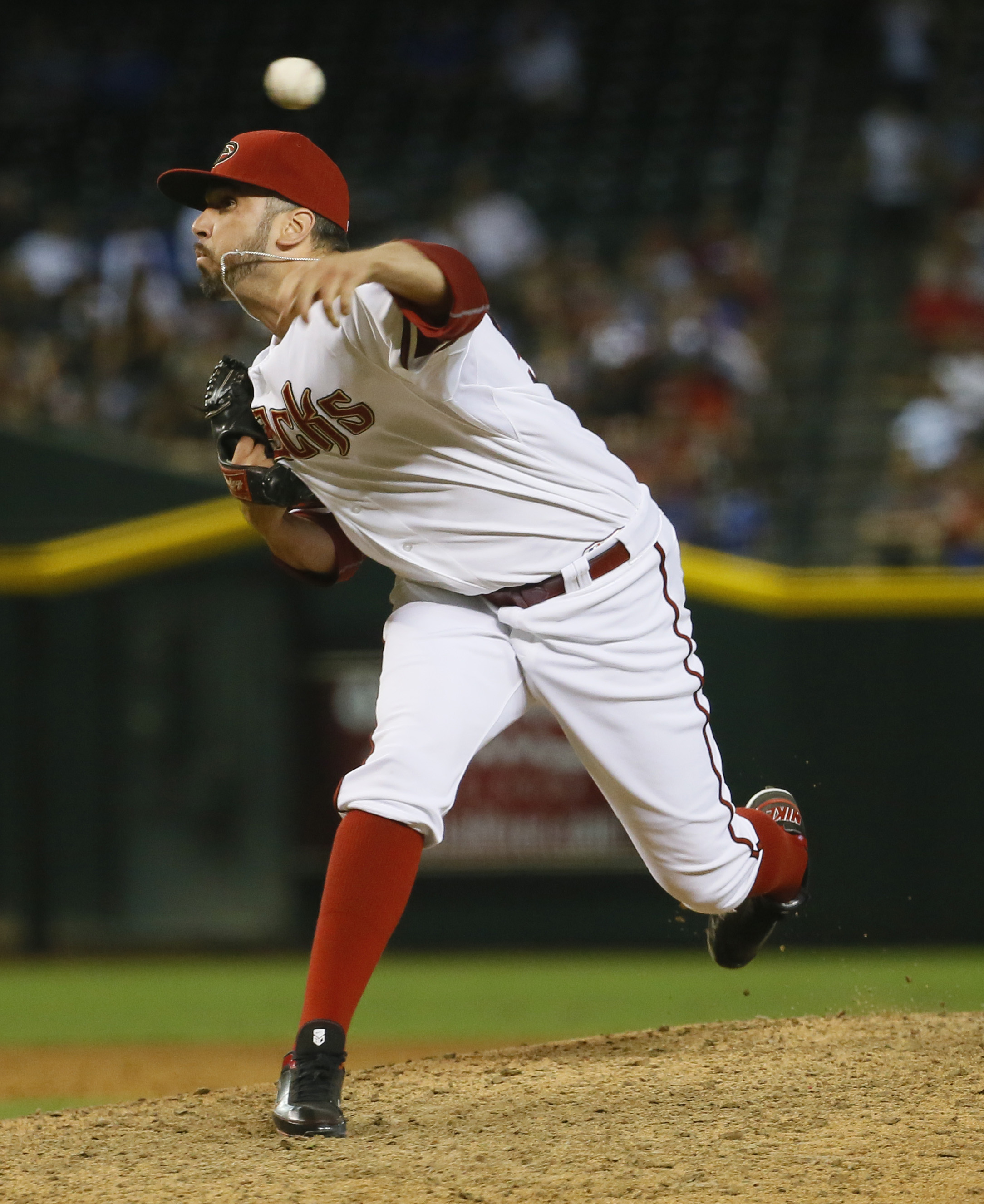 FILE- In this June 30, 2015, file photo, Arizona Diamondbacks relief pitcher Oliver Perez throws against the Los Angeles Dodgers during the sixth inning of a baseball game in Phoenix. The Houston Astros added help in the bullpen Friday, Aug. 7, acquiring