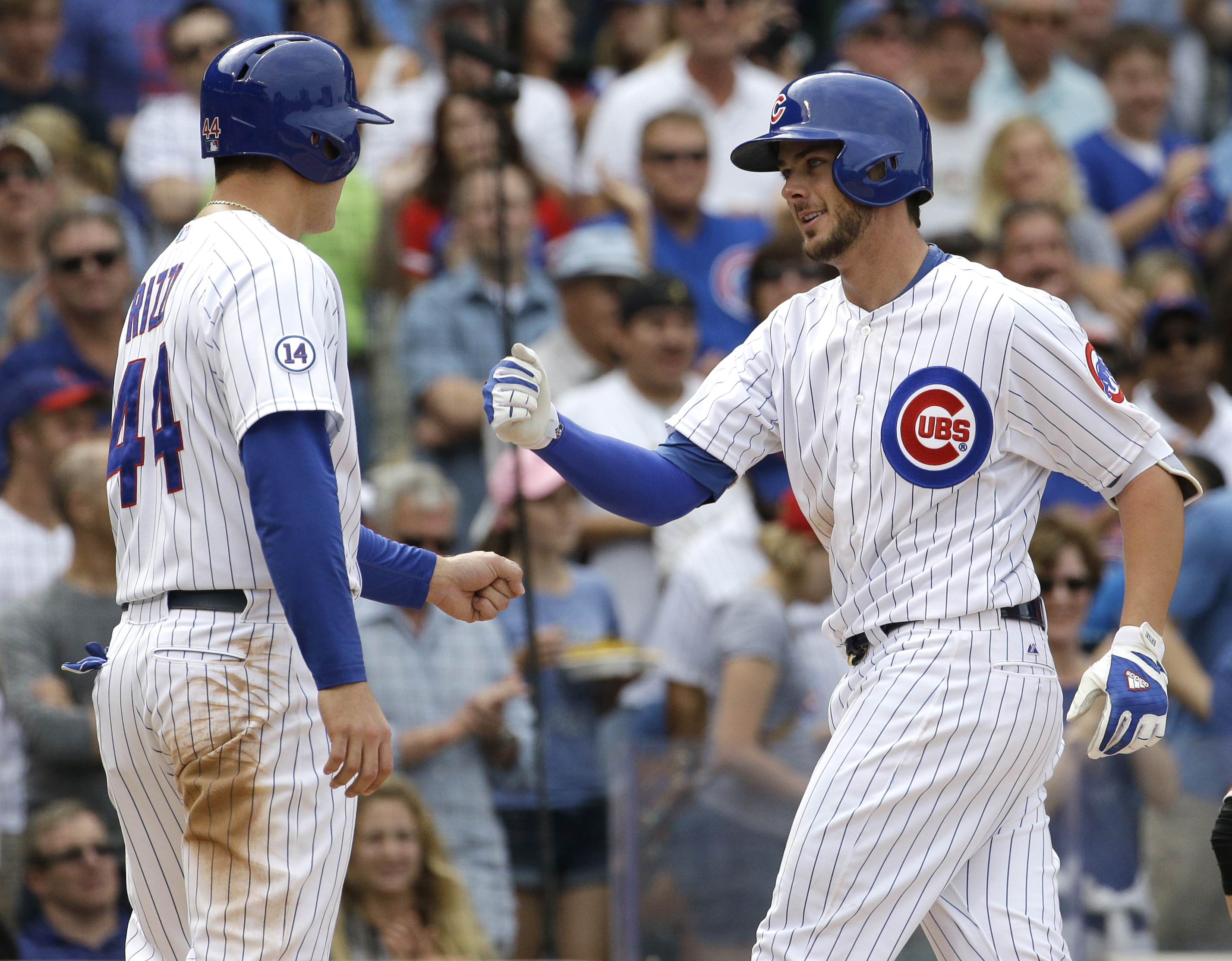 Chicago Cubs' Kris Bryant, right, celebrates with teammate Anthony Rizzo after hitting a two-run home run during the third inning of a baseball game against the San Francisco Giants, Saturday, Aug. 8, 2015, in Chicago. (AP Photo/Nam Y. Huh)