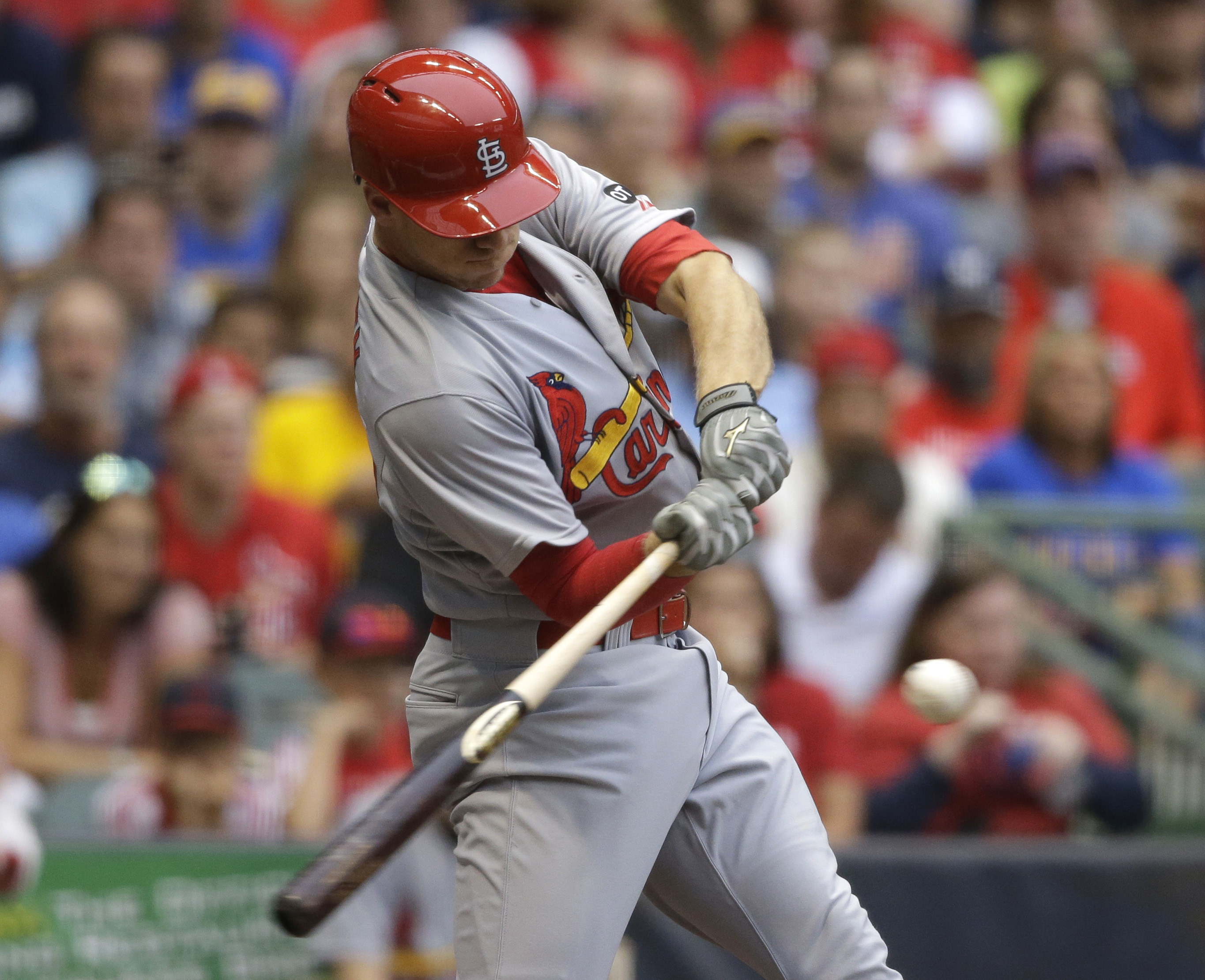 St. Louis Cardinals' Stephen Piscotty hits a run-scoring single against the Milwaukee Brewers during the second inning of a baseball game Saturday, Aug. 8, 2015, in Milwaukee. (AP Photo/Jeffrey Phelps)
