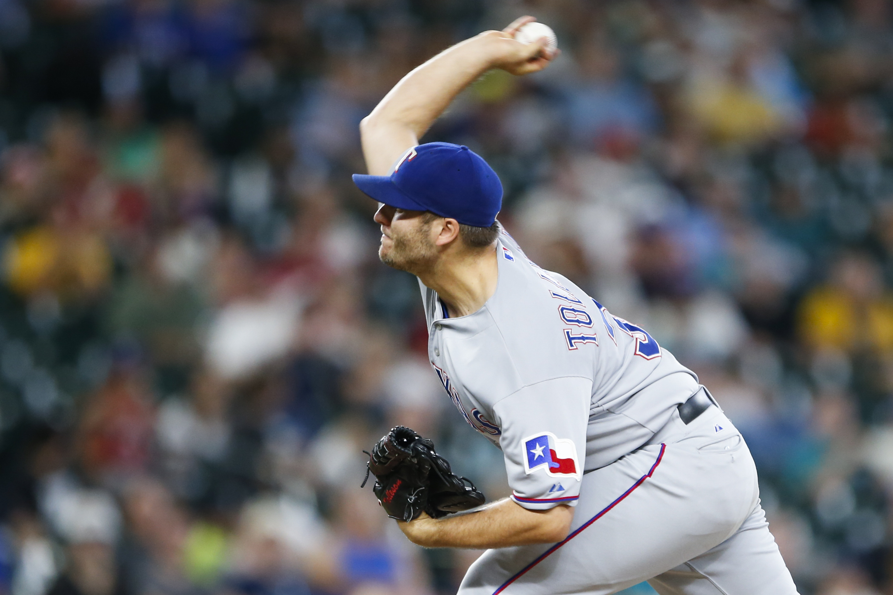 Texas Rangers pitcher Shawn Tolleson throws during the 11th inning out of a baseball game against the Seattle Mariners, Saturday, Aug. 8, 2015, in Seattle. Texas defeated Seattle 11-3 in eleven11