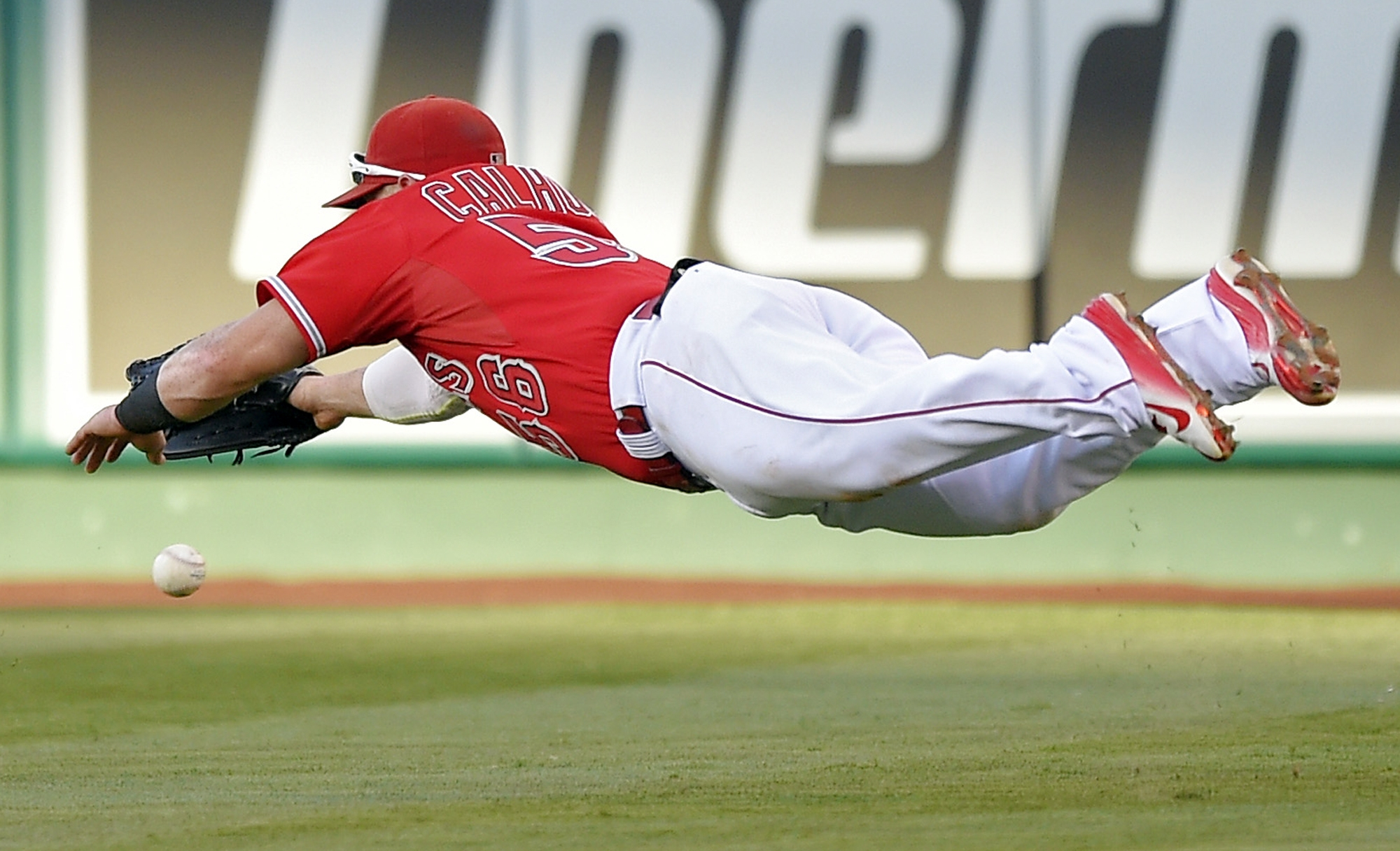 Los Angeles Angels right fielder Kole Calhoun cannot reach a ball hit for a double by Baltimore Orioles' J.J. Hardy during the second inning of a baseball game, Saturday, Aug. 8, 2015, in Anaheim, Calif. (AP Photo/Mark J. Terrill)