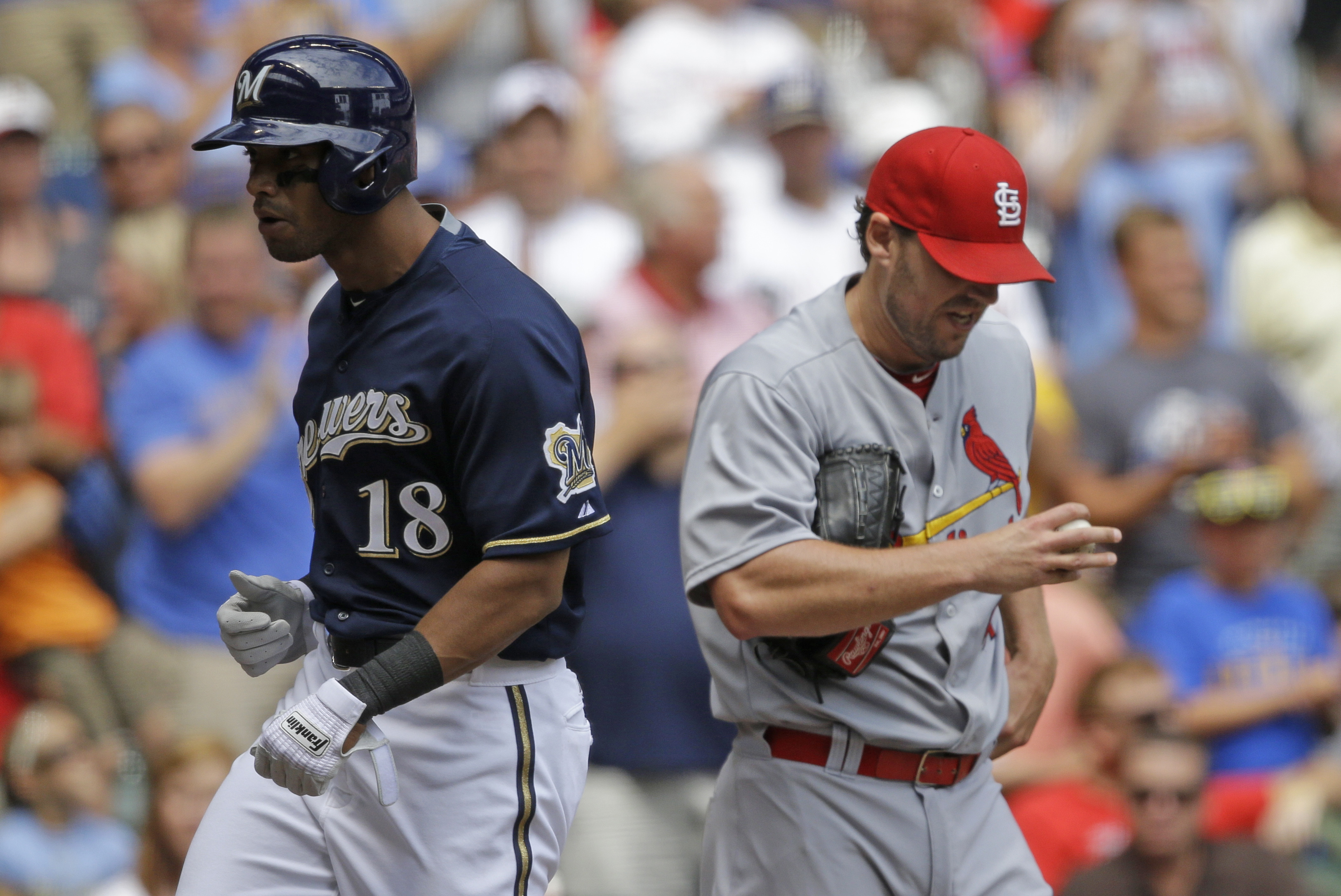 Milwaukee Brewers' Khris Davis(18) crosses home plate after his two-run home run against the St. Louis Cardinals' John Lackey, right, in the third inning of a baseball game, Sunday, Aug. 9, 2015, in Milwaukee. (AP Photo/Jeffrey Phelps)