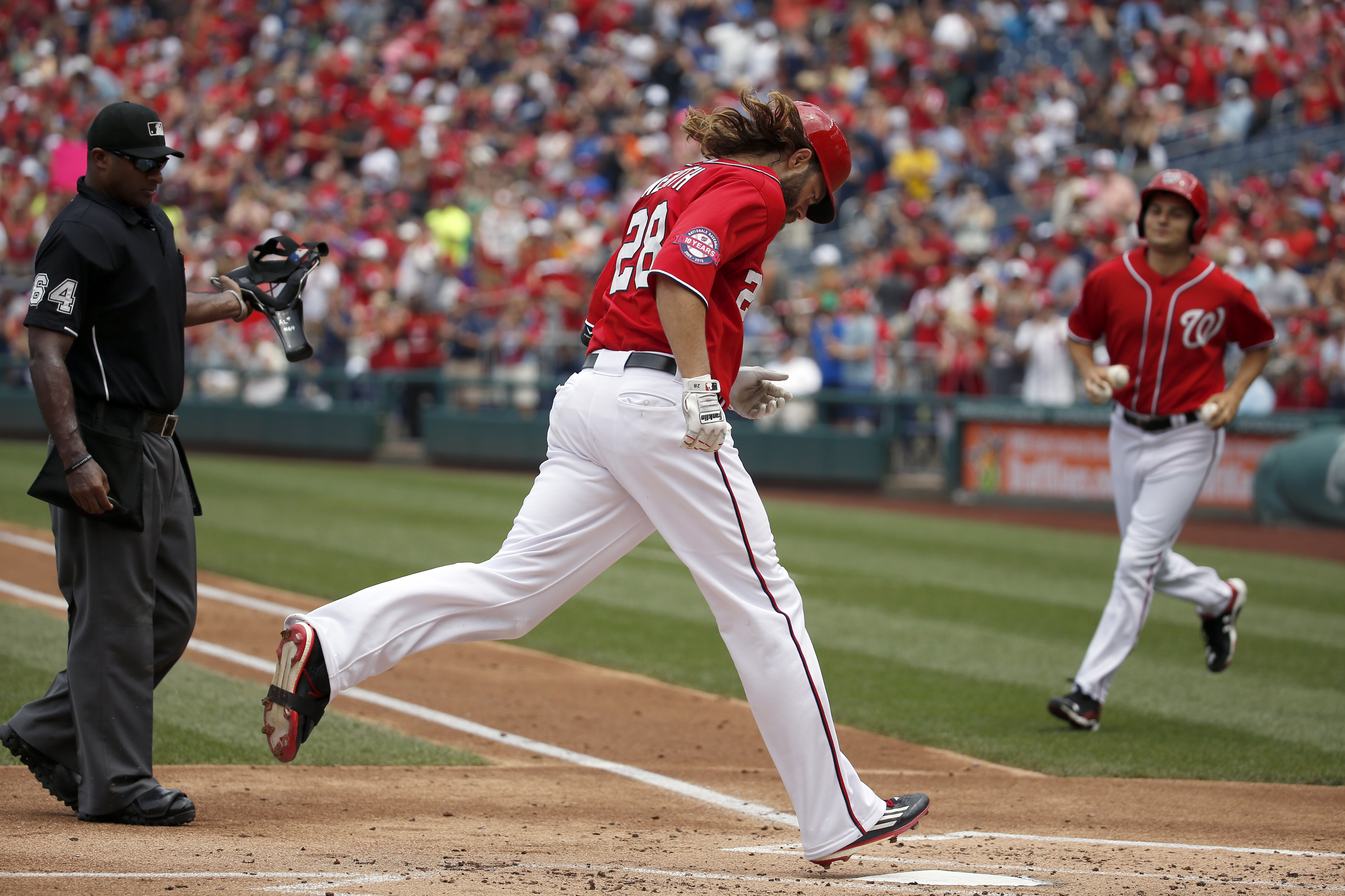Washington Nationals' Jayson Werth (28) steps on home plate for his solo home run during the second inning of a baseball game against the Colorado Rockies at Nationals Park, Sunday, Aug. 9, 2015, in Washington. (AP Photo/Alex Brandon)