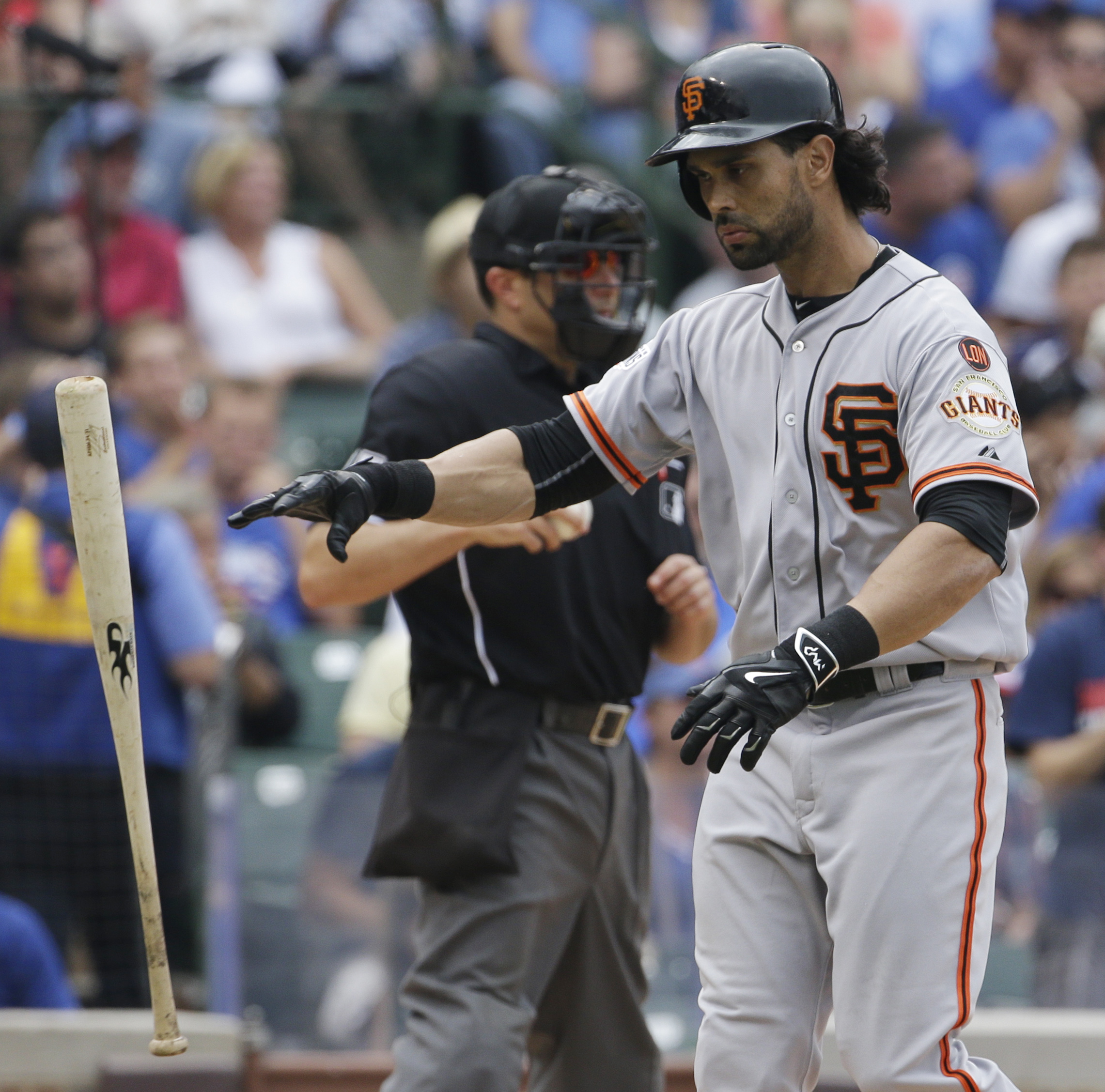 San Francisco Giants' Angel Pagan throws his bat after striking out swinging against the Chicago Cubs during the fifth inning of a baseball game, Sunday, Aug. 9, 2015, in Chicago. (AP Photo/Nam Y. Huh)