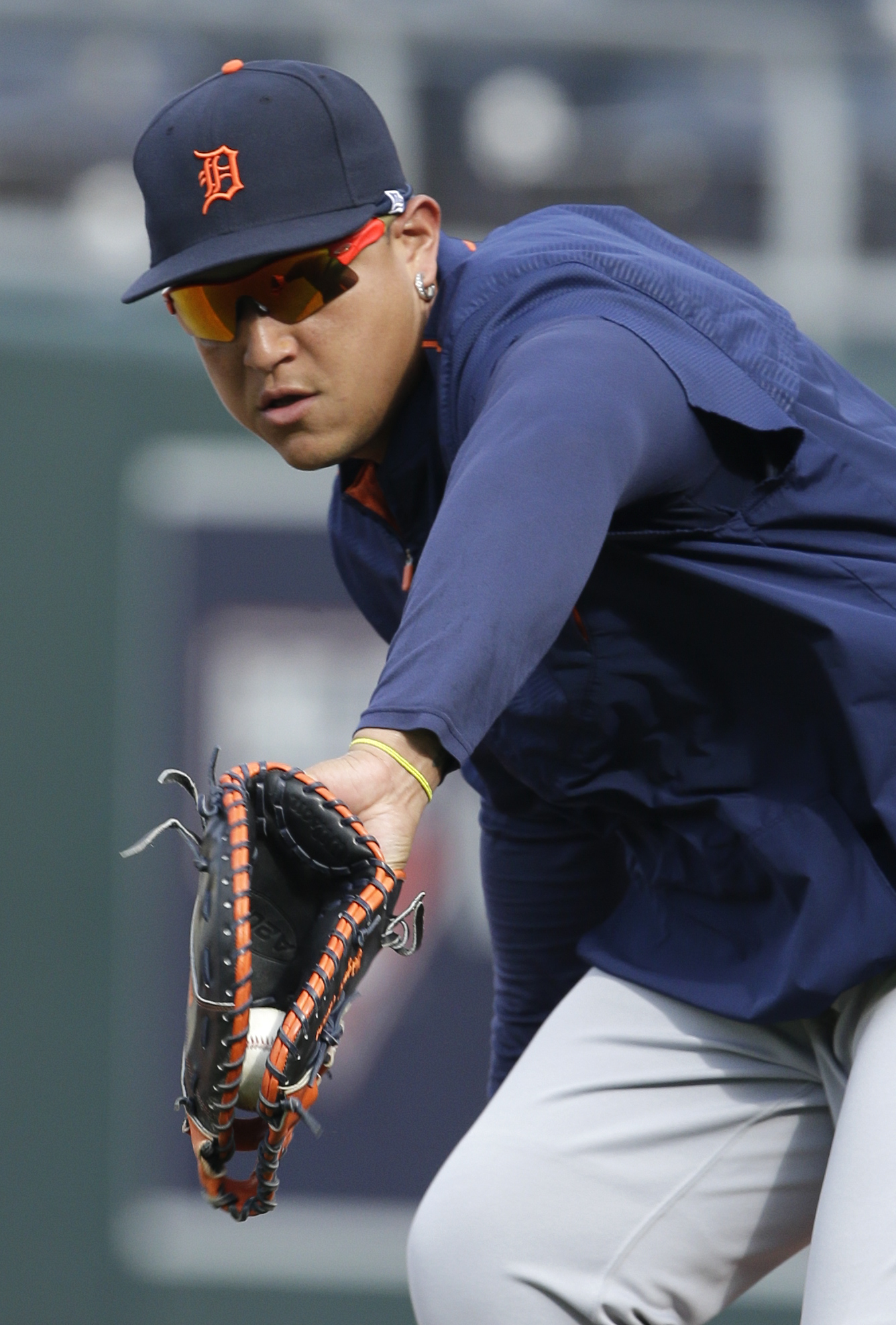 Detroit Tigers first baseman Miguel Cabrera fields a ball during batting practice before a baseball game against the Kansas City Royals at Kauffman Stadium in Kansas City, Mo., Monday, Aug. 10, 2015. (AP Photo/Orlin Wagner)