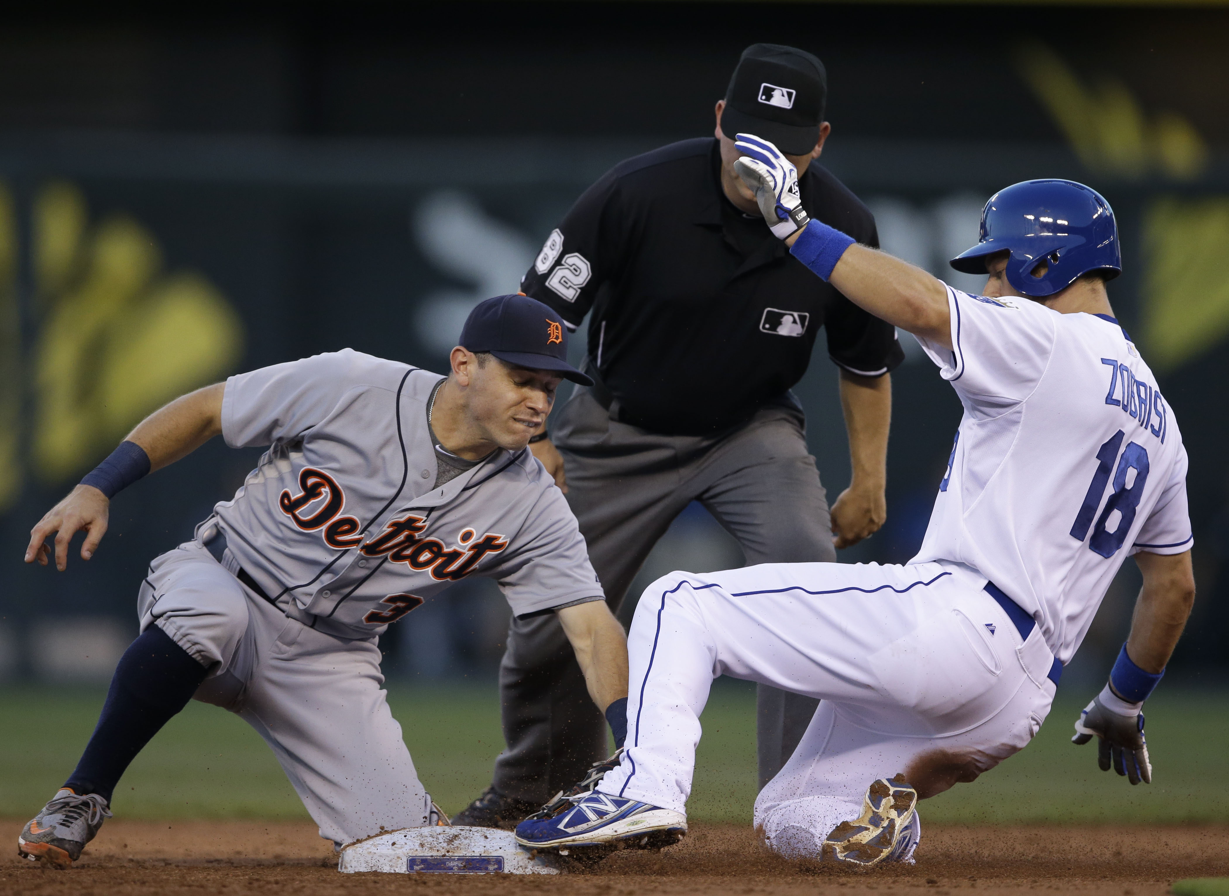 Detroit Tigers second baseman Ian Kinsler, left, tags out Kansas City Royals' Ben Zobrist, right, during the third inning of a baseball game at Kauffman Stadium in Kansas City, Mo., Monday, Aug. 10, 2015. (AP Photo/Orlin Wagner)