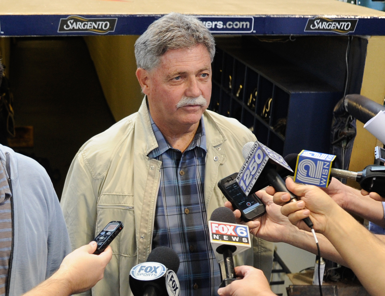 FILE - In this Sept. 27, 2014, file photo, Milwaukee Brewers general manager Doug Melvin speaks to the media before a baseball game against the Chicago Cubs in Milwaukee. Melvin is leaving his job as general manager of the Brewers. The team and Melvin ann