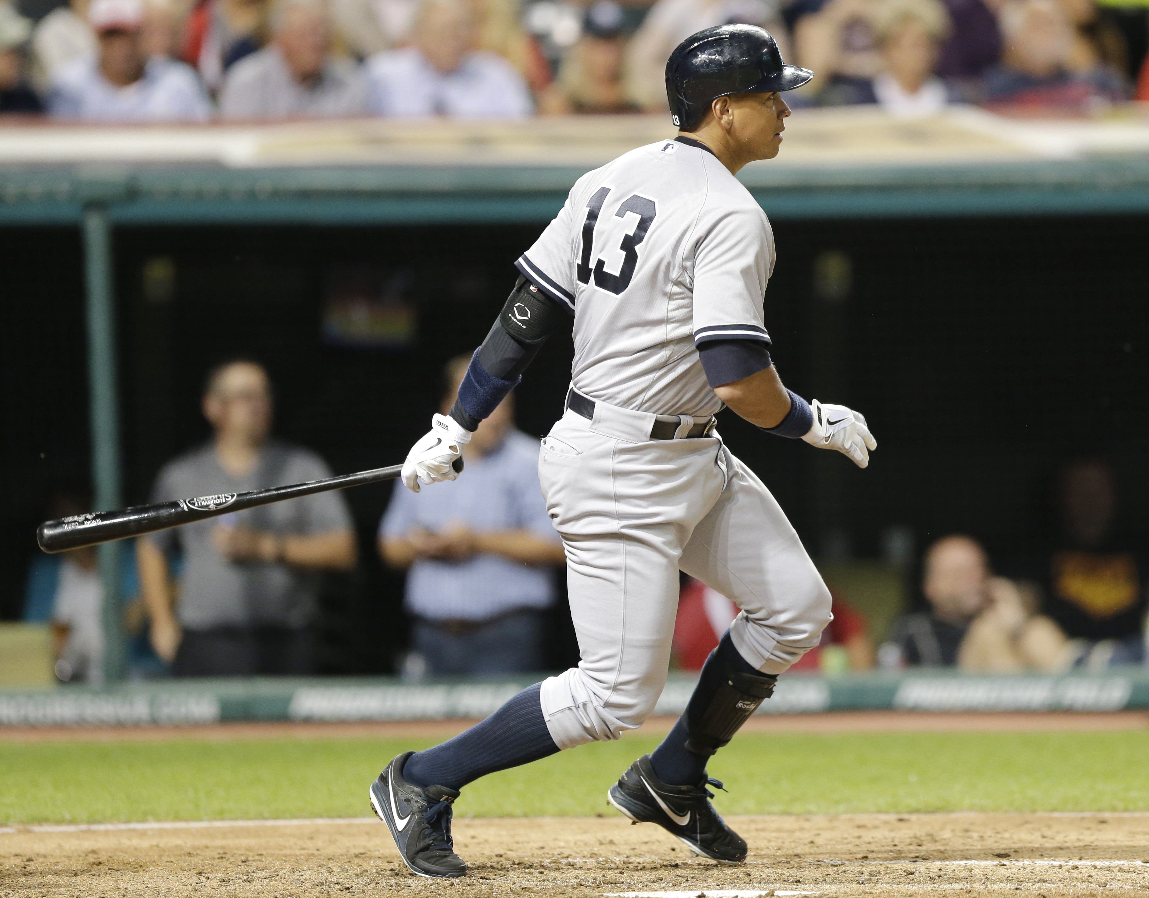 New York Yankees' Alex Rodriguez hits a single off Cleveland Indians starting pitcher Carlos Carrasco in the seventh inning of a baseball game, Tuesday, Aug. 11, 2015, in Cleveland. (AP Photo/Tony Dejak)