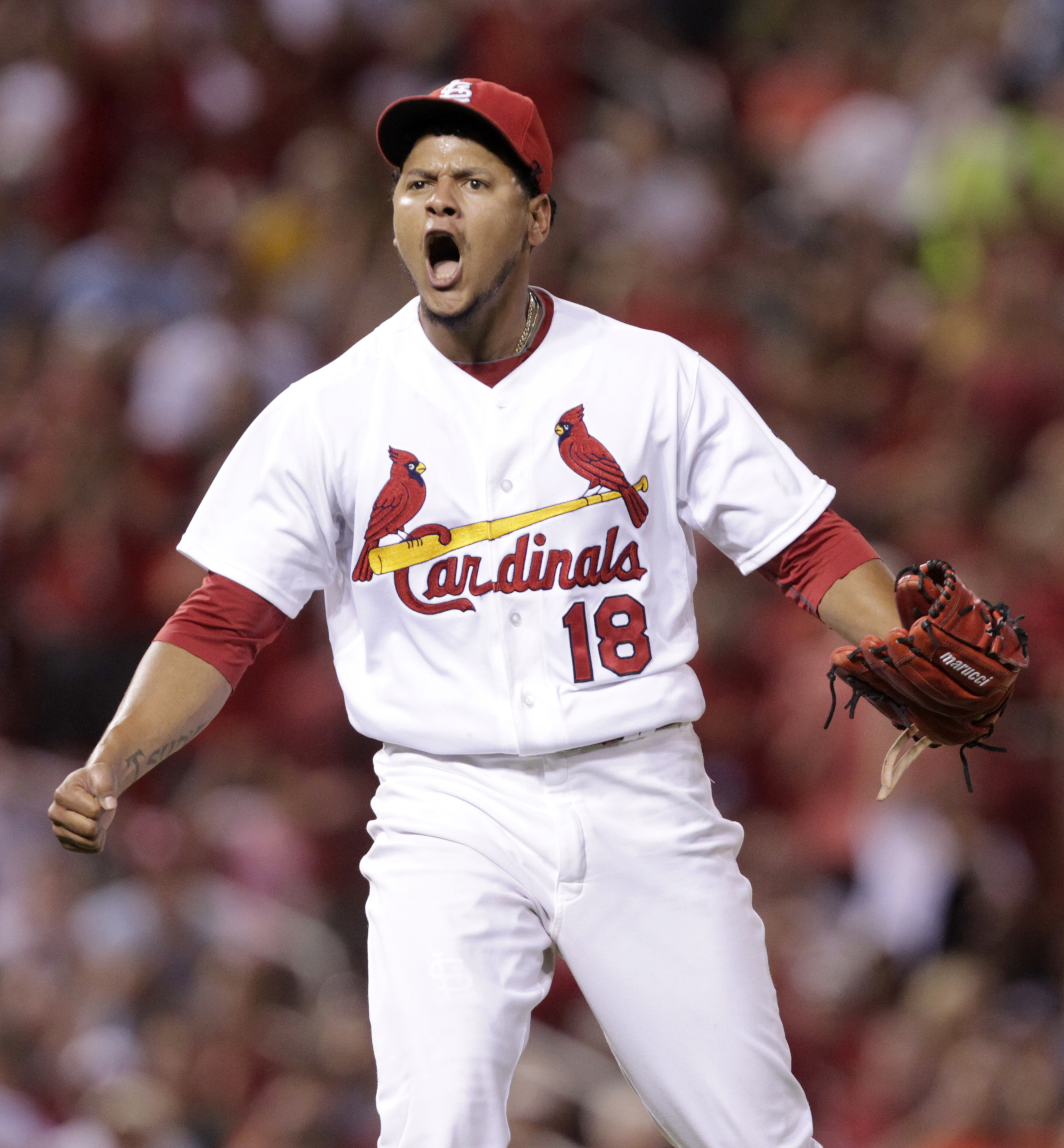 St. Louis Cardinals starting pitcher Carlos Martinez (18) reacts to striking out Pittsburgh Pirates' Jung Ho Kang to end the eighth inning in a baseball game, Tuesday, Aug. 11, 2015, in St. Louis. (AP Photo/Tom Gannam)