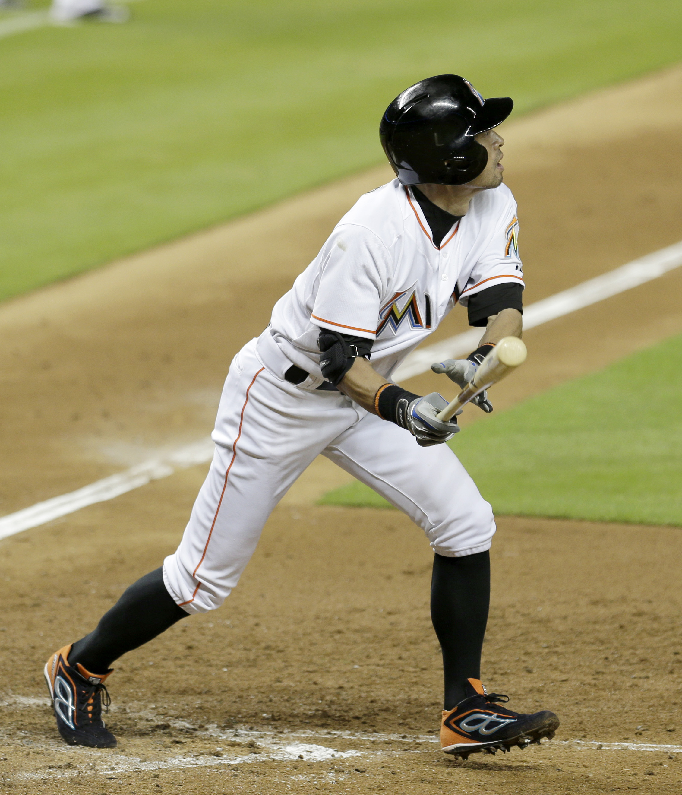 Miami Marlins' Ichiro Suzuki watches his sacrifice fly ball to right field against the Boston Red Sox in the seventh inning of a baseball game, Tuesday, Aug. 11, 2015, in Miami. Derek Dietrich scored on the sacrifice fly. The Marlins won 5-4. (AP Photo/Al