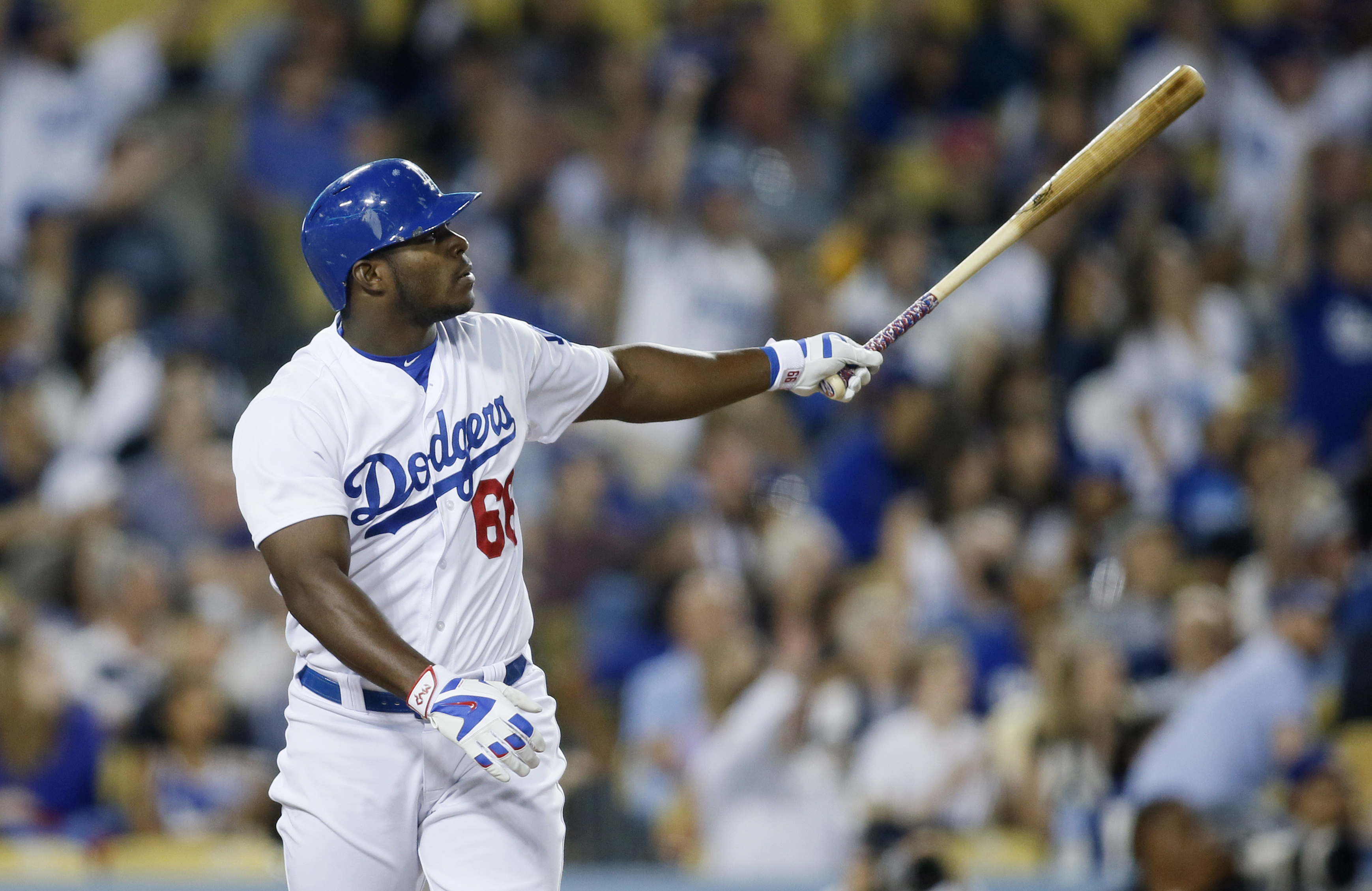 Los Angeles Dodgers' Yasiel Puig watches his two-run home run, driving Andre Ethier, against the Washington Nationals during the fourth inning of a baseball game, Tuesday, Aug. 11, 2015, in Los Angeles. (AP Photo/Danny Moloshok)