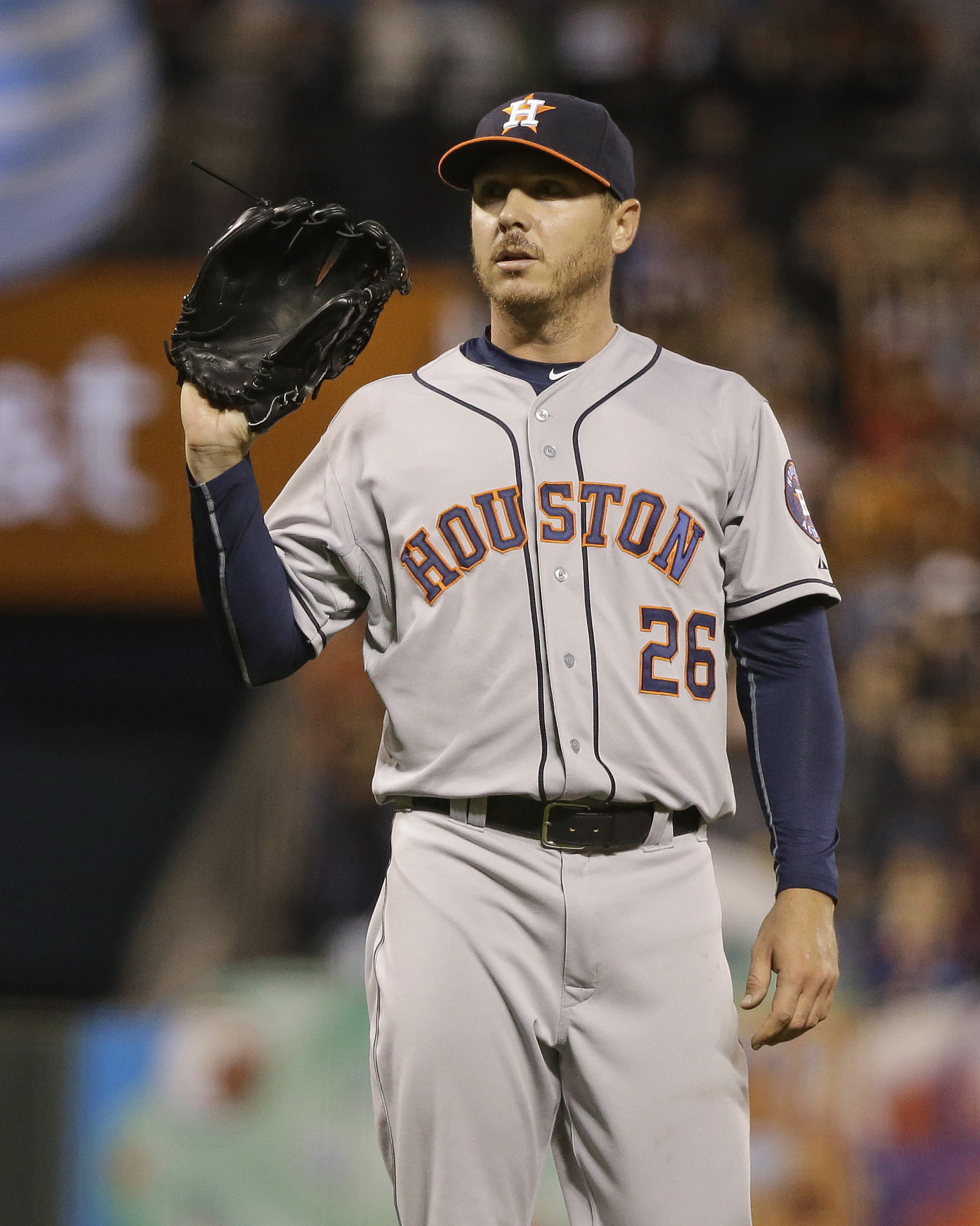 Houston Astros starting pitcher Scott Kazmir stands on the mound after giving up a home run to the San Francisco Giants' Brandon Belt in the fourth inning of their baseball game, Tuesday, Aug. 11, 2015, in San Francisco. (AP Photo/Eric Risberg)