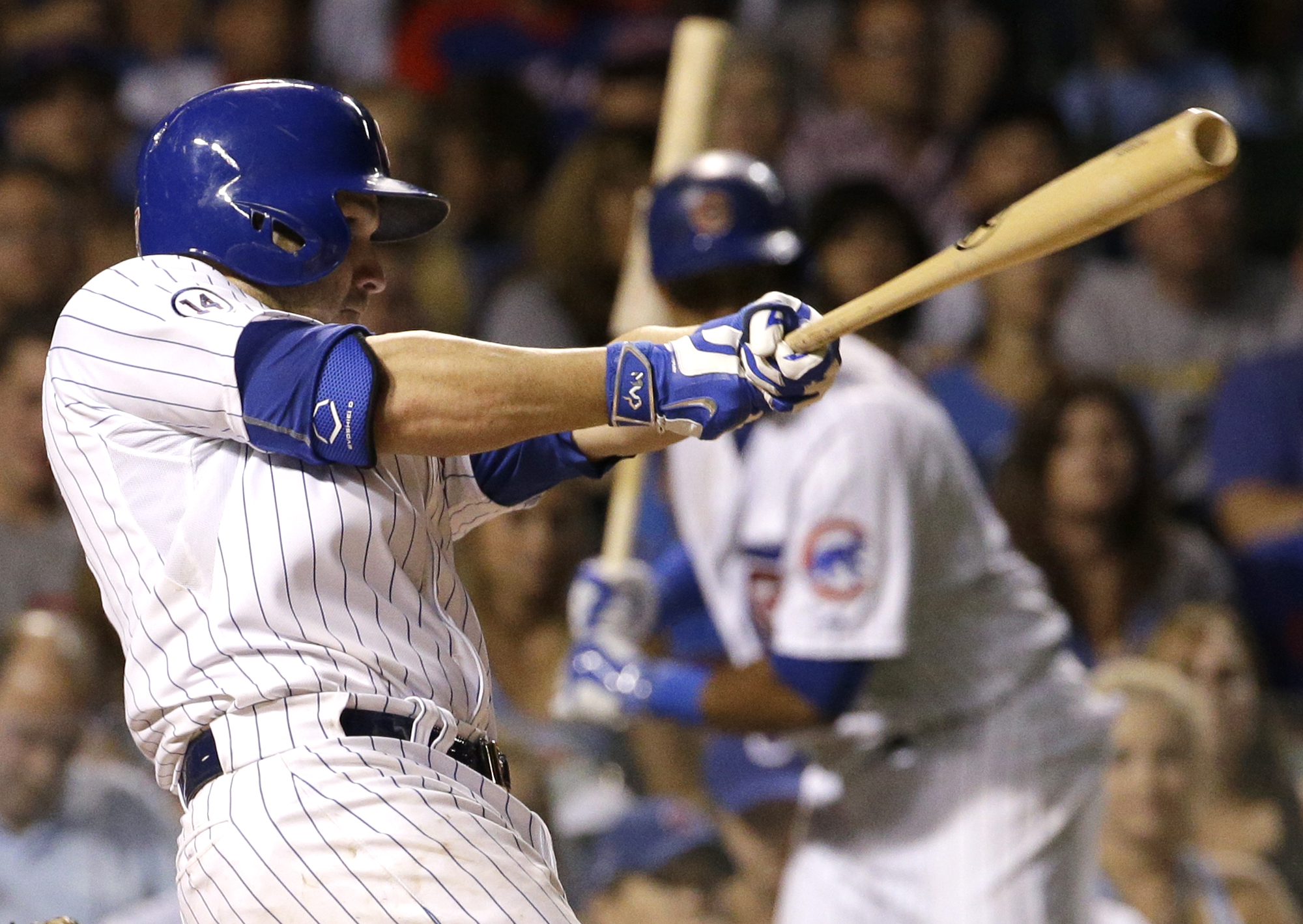 Chicago Cubs' Miguel Montero hits the game-winning solo home run against the Milwaukee Brewers during the 10th inning of a baseball game Wednesday, Aug. 12, 2015, in Chicago. The Cubs won 3-2. (AP Photo/Nam Y. Huh)