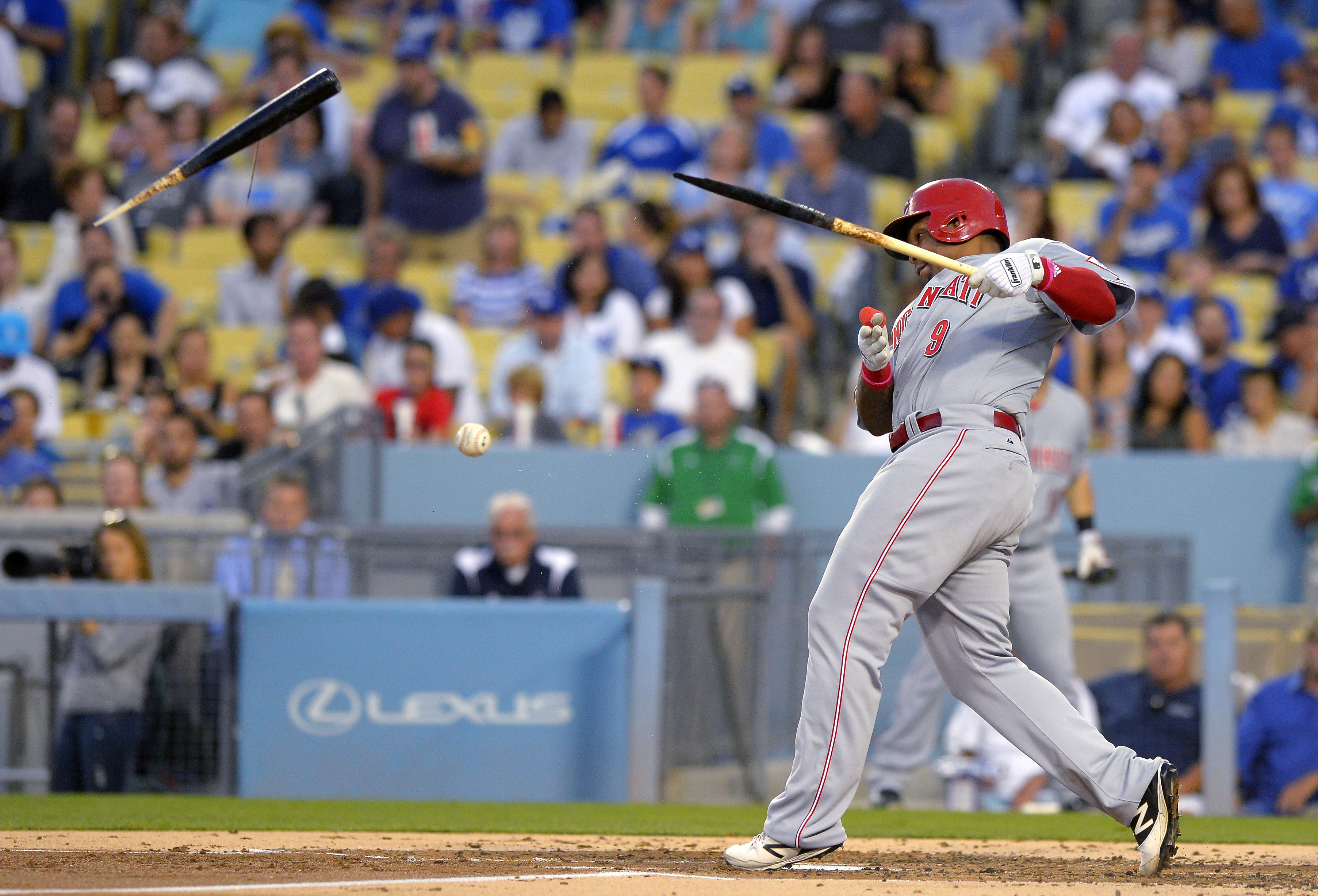Cincinnati Reds' Marlon Byrd breaks his bat as he hits a foul ball during the second inning of a baseball game against the Los Angeles Dodgers, Thursday, Aug. 13, 2015, in Los Angeles. (AP Photo/Mark J. Terrill)
