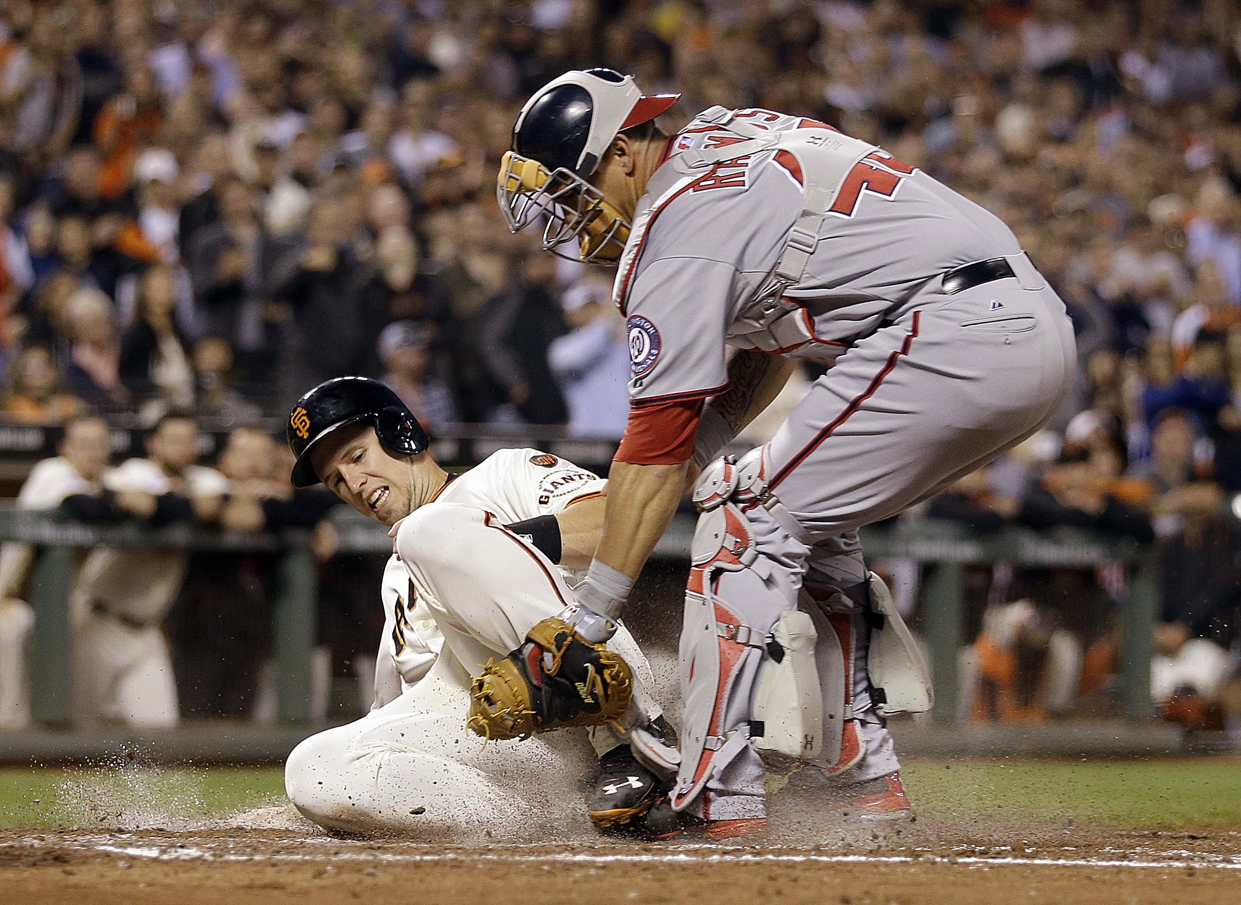 Washington Nationals catcher Wilson Ramos, right, tags out San Francisco Giants' Buster Posey at home plate in the third inning of a baseball game Thursday, Aug. 13, 2015, in San Francisco. Posey was trying to score on a hit by Giants' Hunter Pence. (AP P