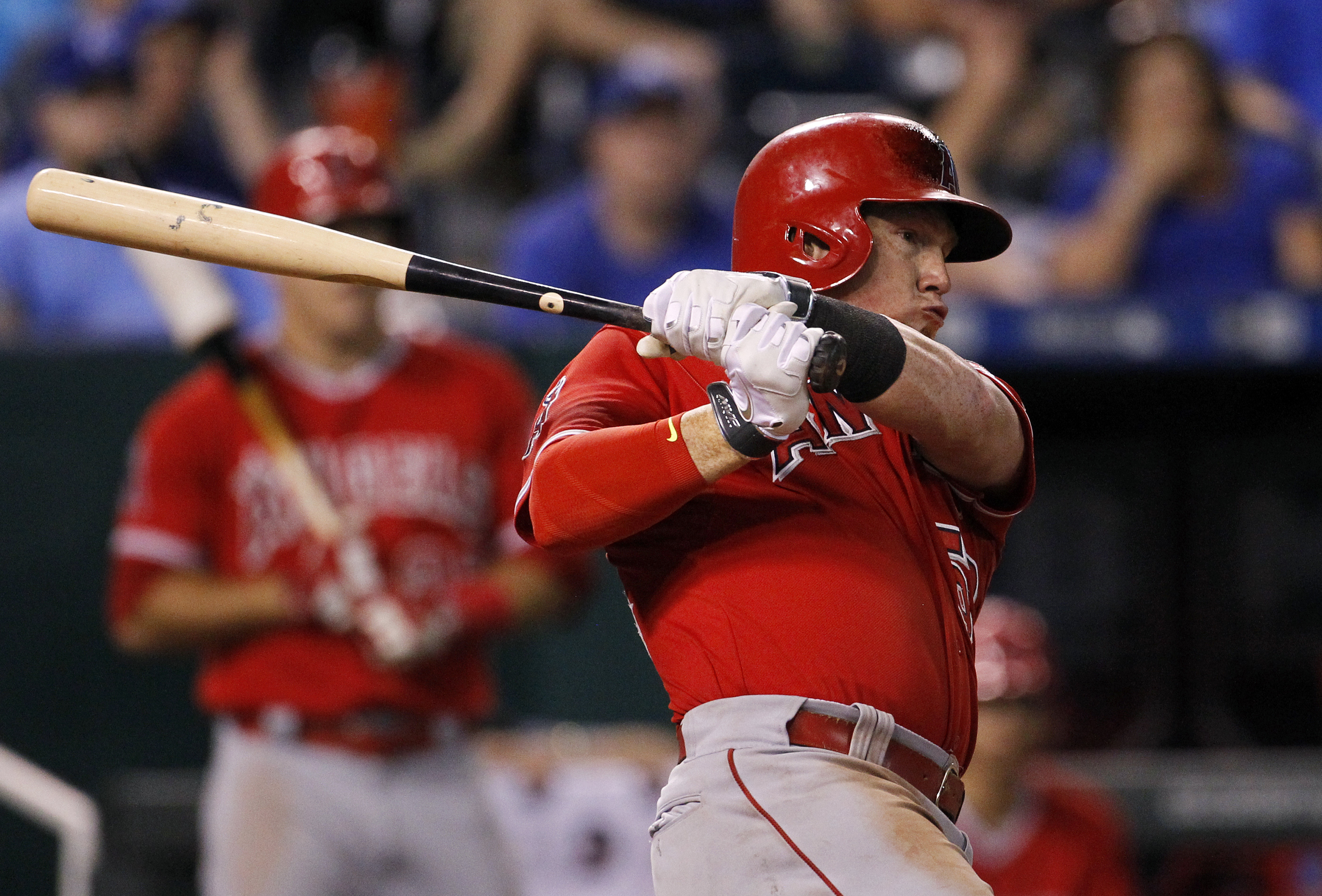 Los Angeles Angels' Kole Calhoun connects for a double, scoring two runs in the ninth inning of a baseball game against the Kansas City Royals, at Kauffman Stadium in Kansas City, Mo., Thursday, Aug. 13, 2015. (AP Photo/Colin E. Braley)
