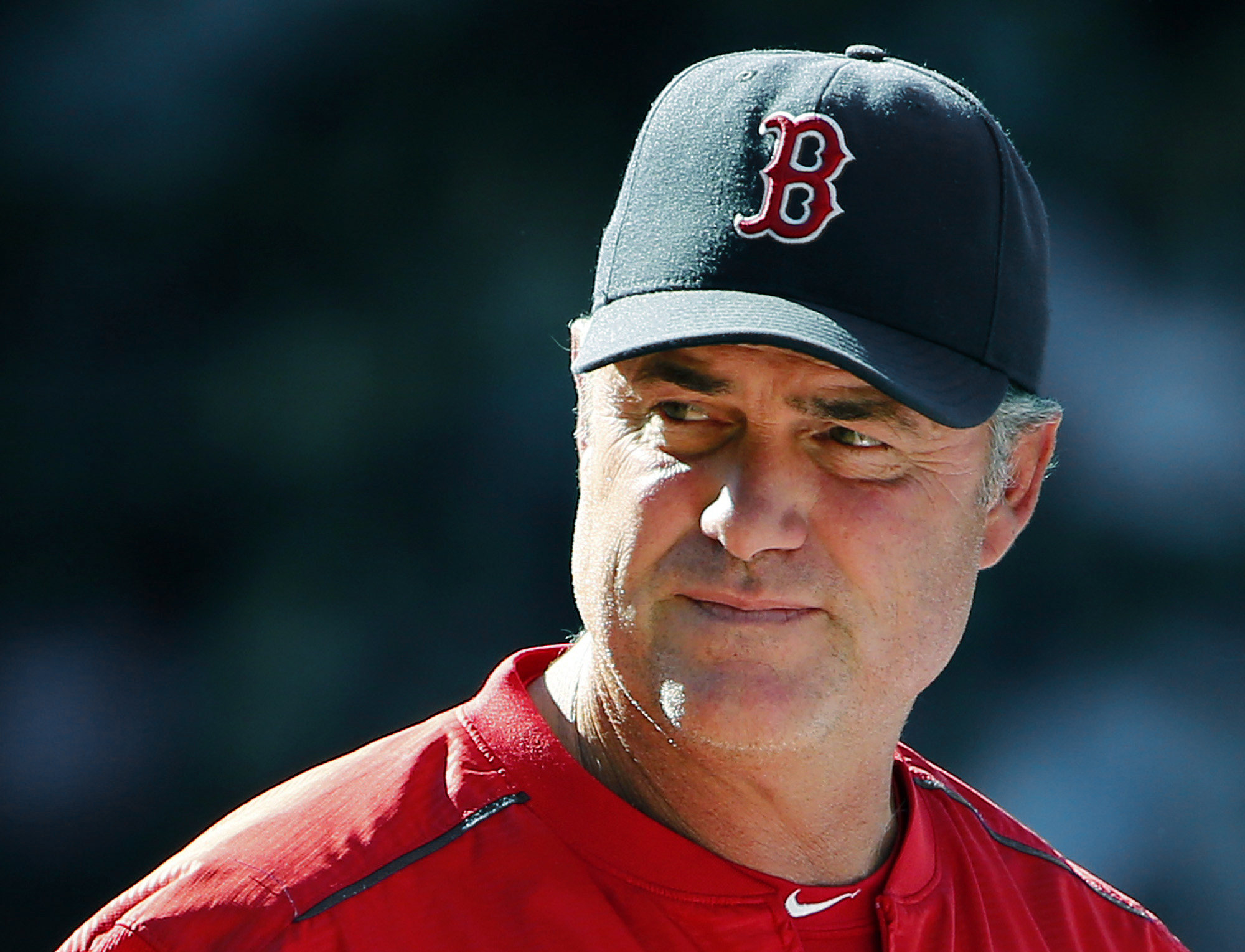 FILE - In this Aug. 2, 2015 file photo, Boston Red Sox manager John Farrell watches action during the eighth inning of a baseball game against the Tampa Bay Rays at Fenway Park in Boston. Farrell said Friday, Aug. 14, 2015, he would take a medical leave f