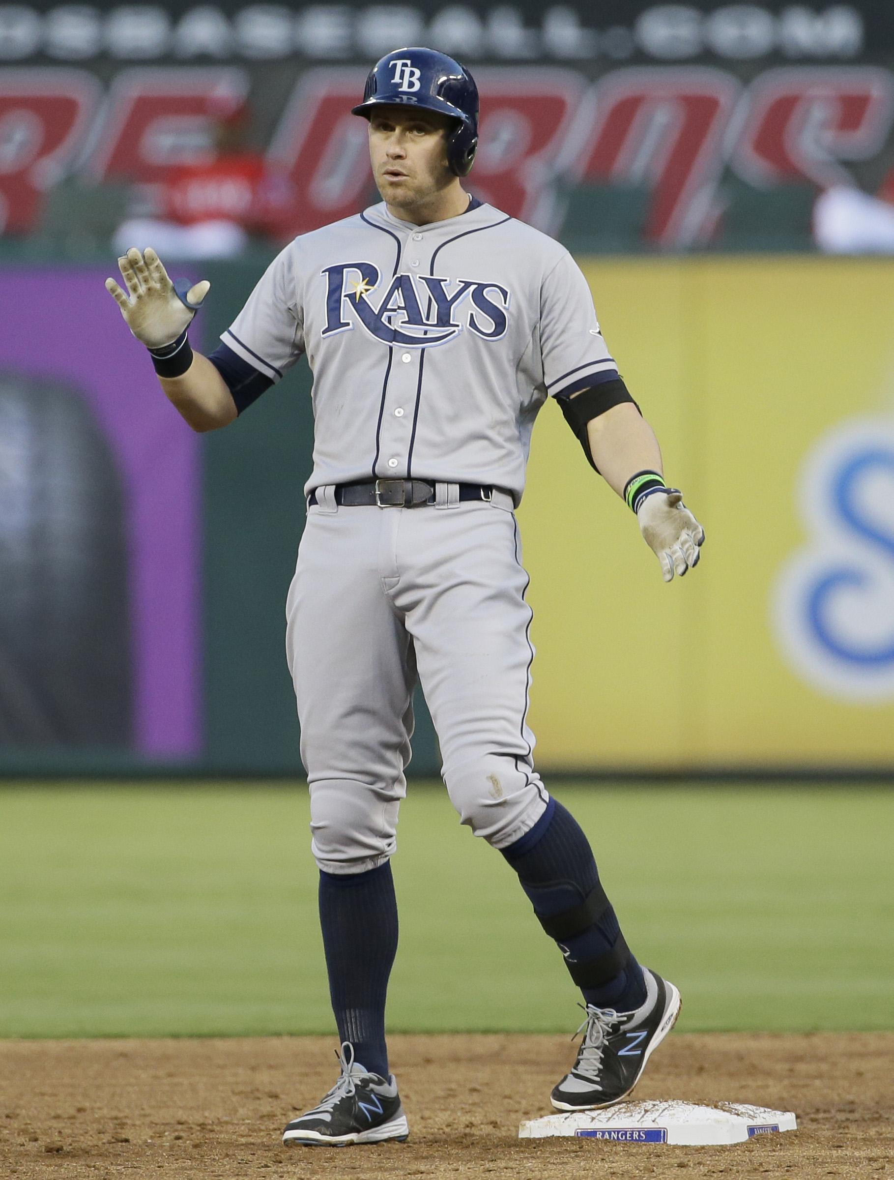 Tampa Bay Rays Evan Longoria stands on second base after hitting an RBI double during the third inning of a baseball game against the Texas Rangers in Arlington, Texas, Friday, Aug. 14, 2015. Rays Curt Casali and Brandon Guyer scored on the play. (AP Phot