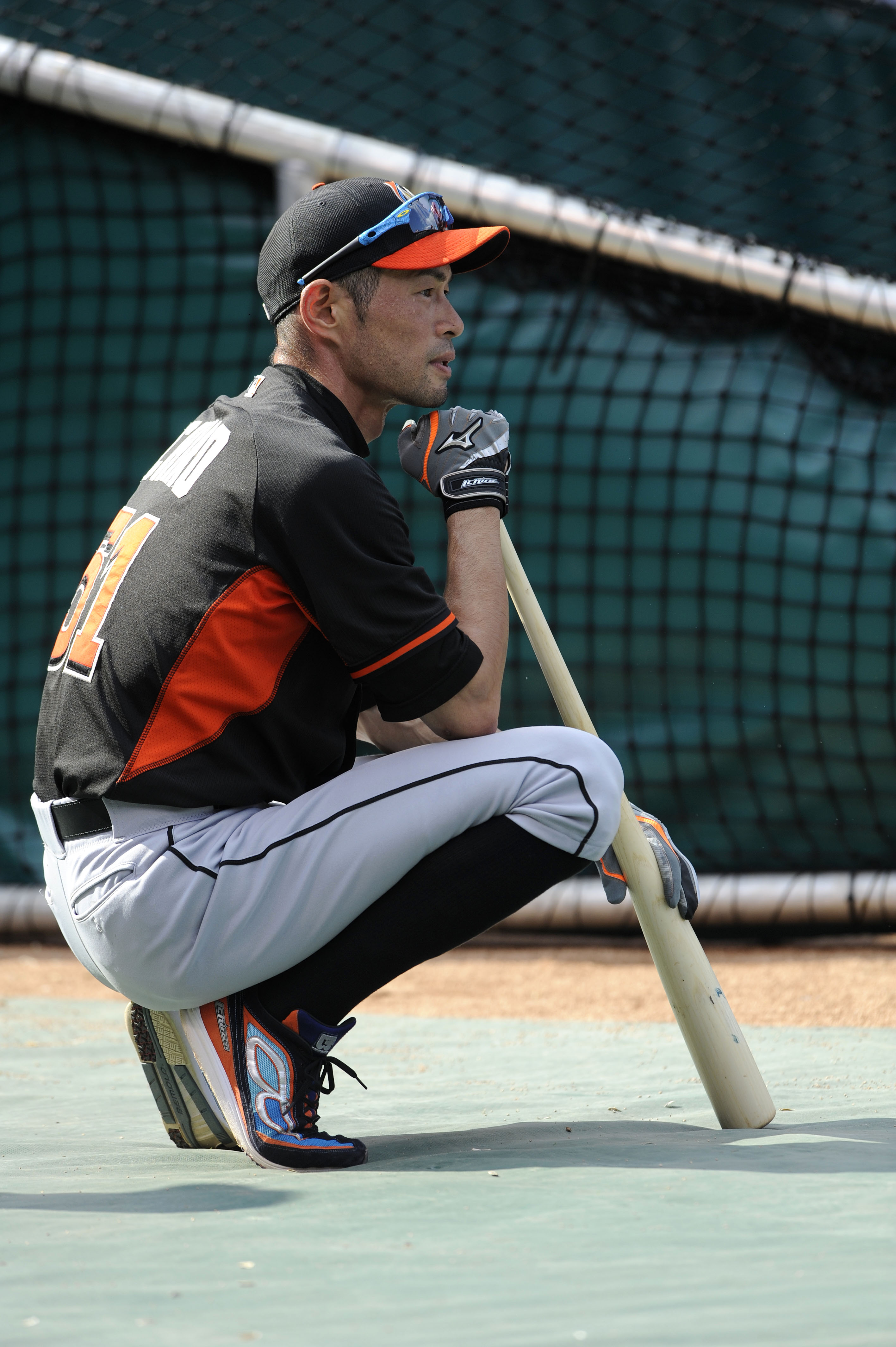 Miami Marlins' Ichiro Suzuki (51) waits at the batting cage prior to the baseball game with the St. Louis Cardinals, Saturday, Aug. 15, 2015, at Busch Stadium in St. Louis. (AP Photo/Bill Boyce)