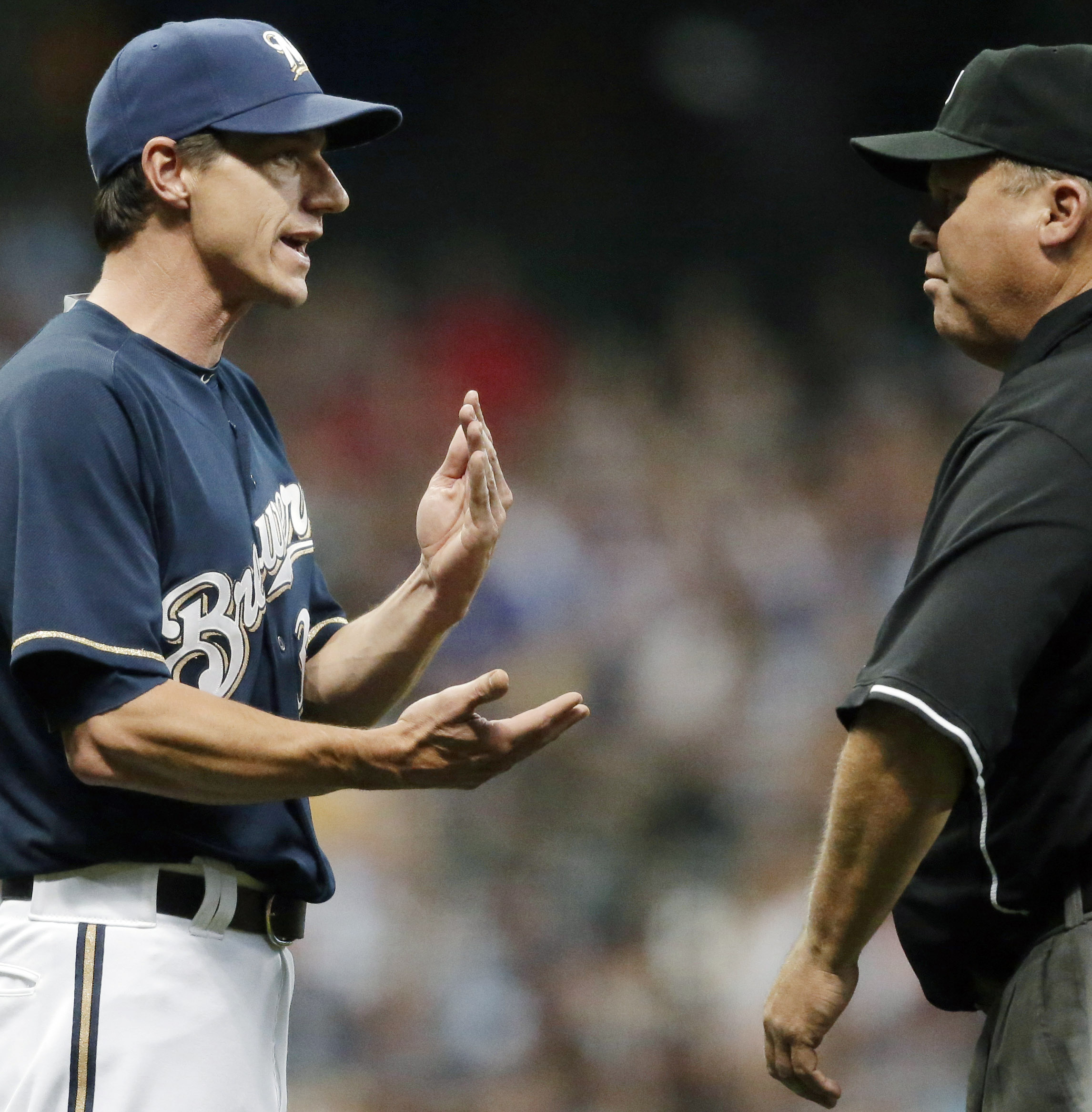 Milwaukee Brewers Manager Craig Counsell, left, argues a call with umpire Fieldin Culbreth during the seventh inning of a baseball game Saturday, Aug. 15, 2015, in Milwaukee. Counsell was tossed from the game. (AP Photo/Jeffrey Phelps)