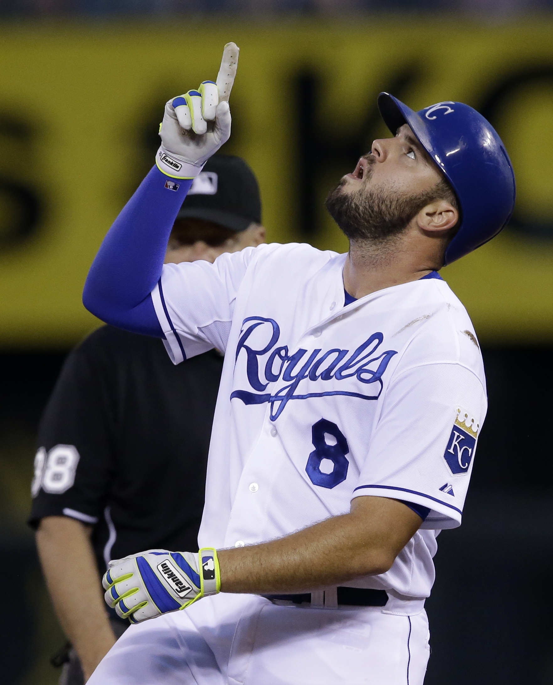 Kansas City Royals' Mike Moustakas gestures after hitting a double during the sixth inning of a baseball game against the Los Angeles Angels at Kauffman Stadium in Kansas City, Mo., Saturday, Aug. 15, 2015. (AP Photo/Orlin Wagner)