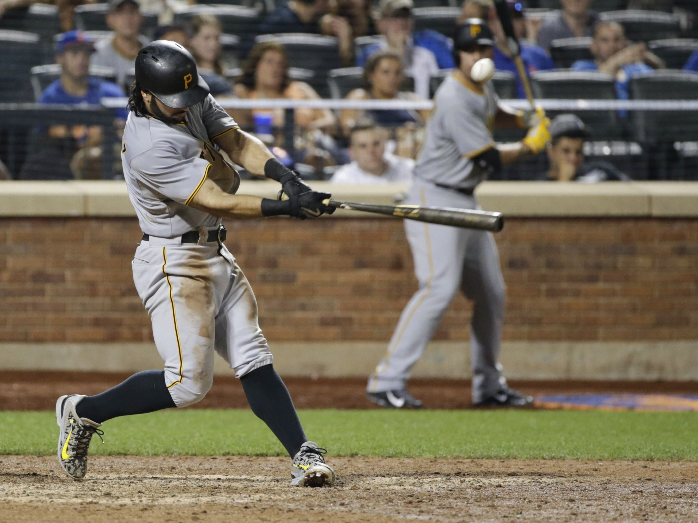 Pittsburgh Pirates' Sean Rodriguez (3) hits an hits an RBI single during the 14th inning of a baseball game against the New York Mets Saturday, Aug. 15, 2015, in New York. (AP Photo/Frank Franklin II)