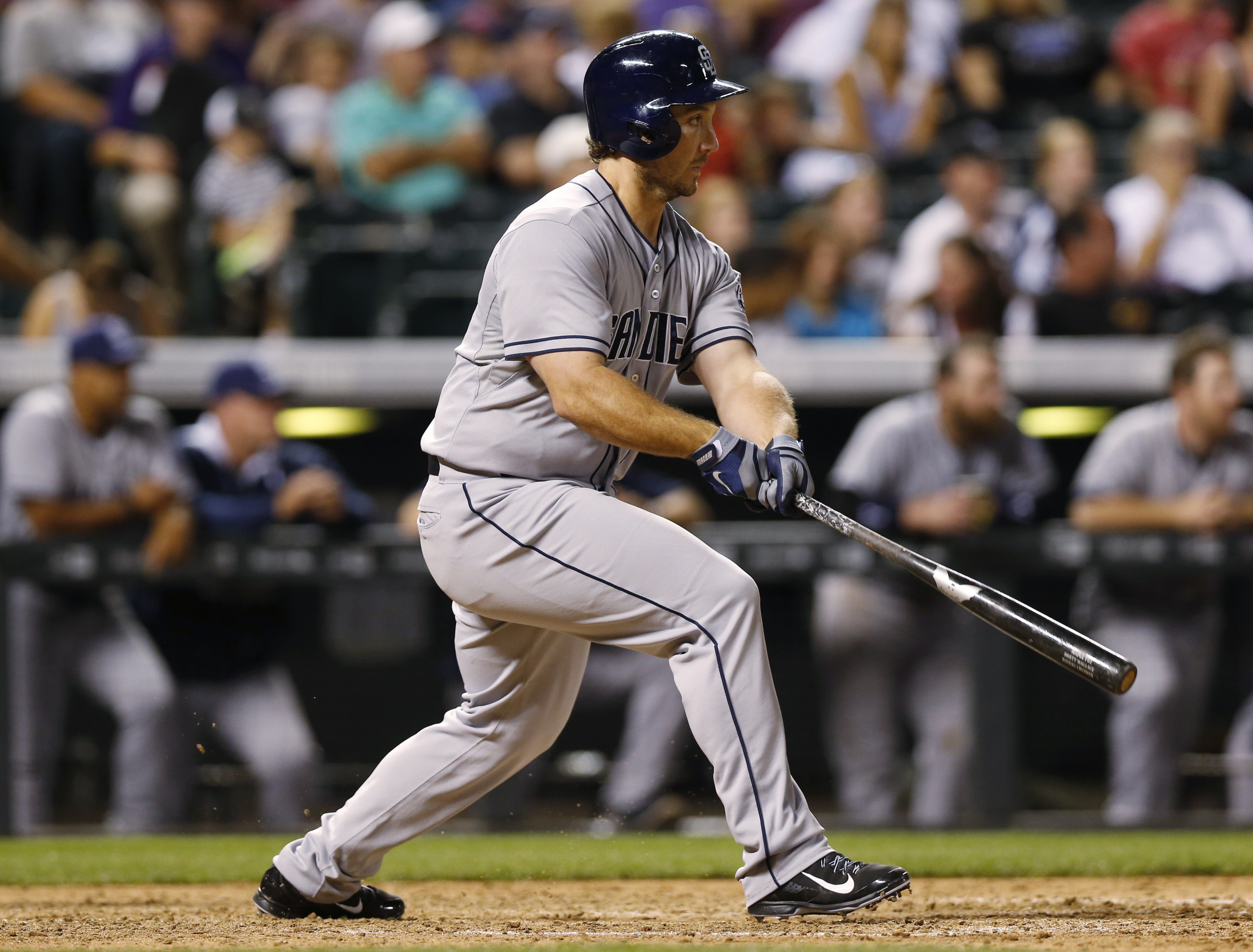 San Diego Padres pinch-hitter Brett Wallace watches his single that drove in the go-ahead run off Colorado Rockies relief pitcher Tommy Kahnle during the ninth inning of a baseball game Saturday, Aug. 15, 2015, in Denver. San Diego won 7-5. (AP Photo/Davi