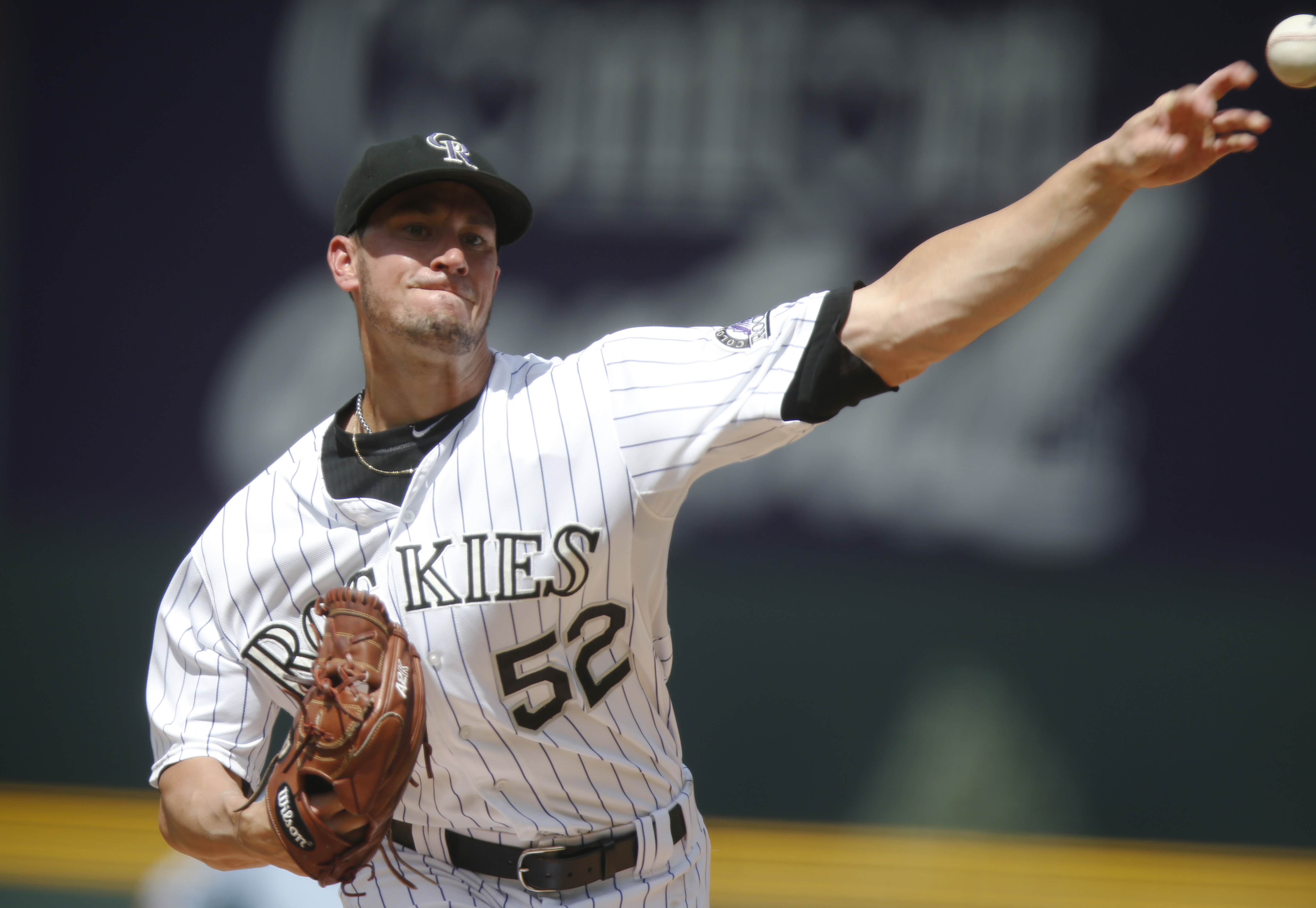 Colorado Rockies starting pitcher Chris Rusin works against the San Diego Padres in the first inning of a baseball game Sunday, Aug. 16, 2015, in Denver. (AP Photo/David Zalubowski)