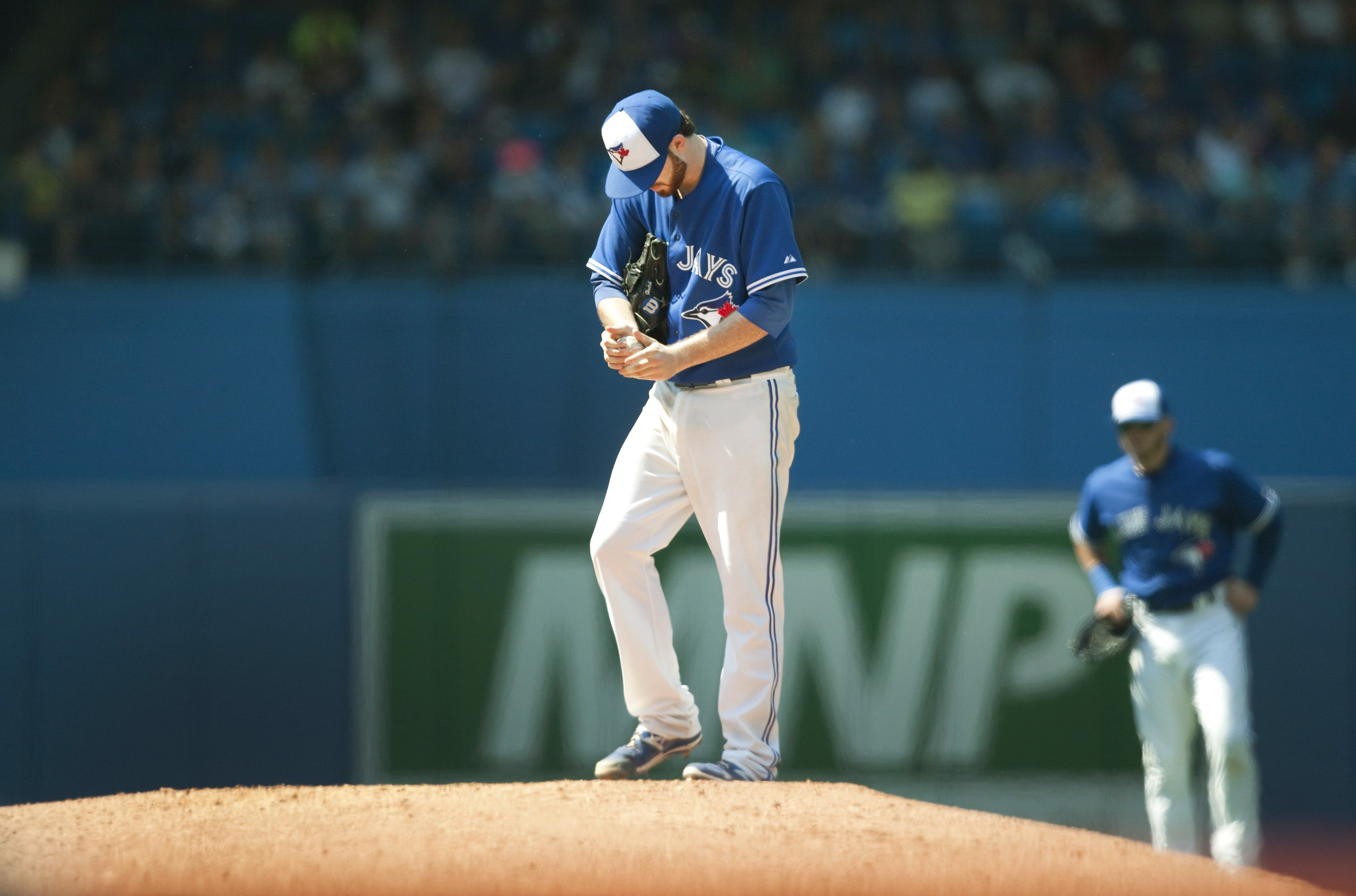 Toronto Blue Jays starting pitcher Drew Hutchison pauses on the mound before throwing against the New York Yankees during the sixth inning of a baseball game in Toronto on Sunday, Aug. 16, 2015. (Fred Thornhill /The Canadian Press via AP) MANDATORY CREDIT