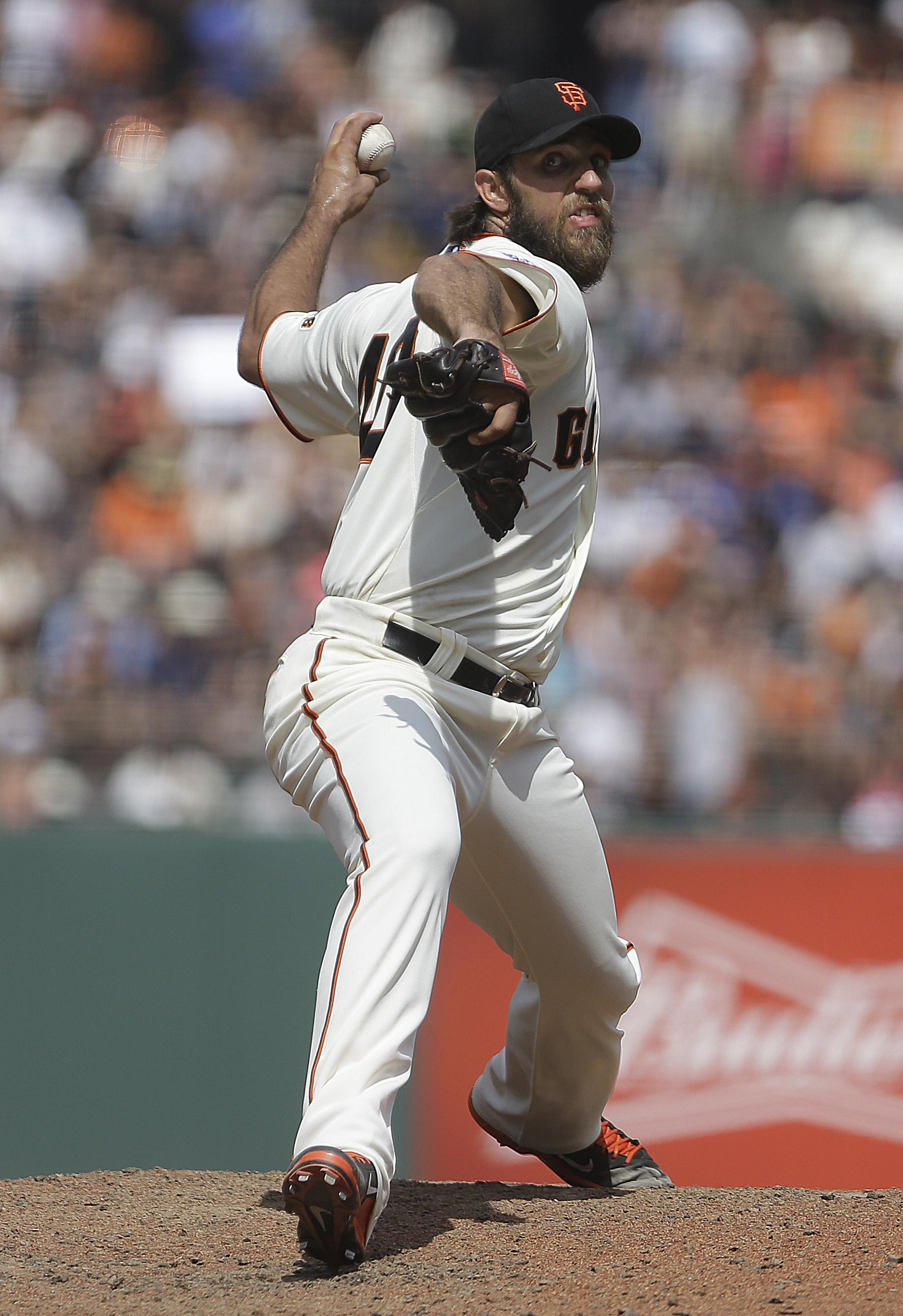 San Francisco Giants pitcher Madison Bumgarner works against the Washington Nationals in the ninth inning of a baseball game Sunday, Aug. 16, 2015, in San Francisco. (AP Photo/Ben Margot)