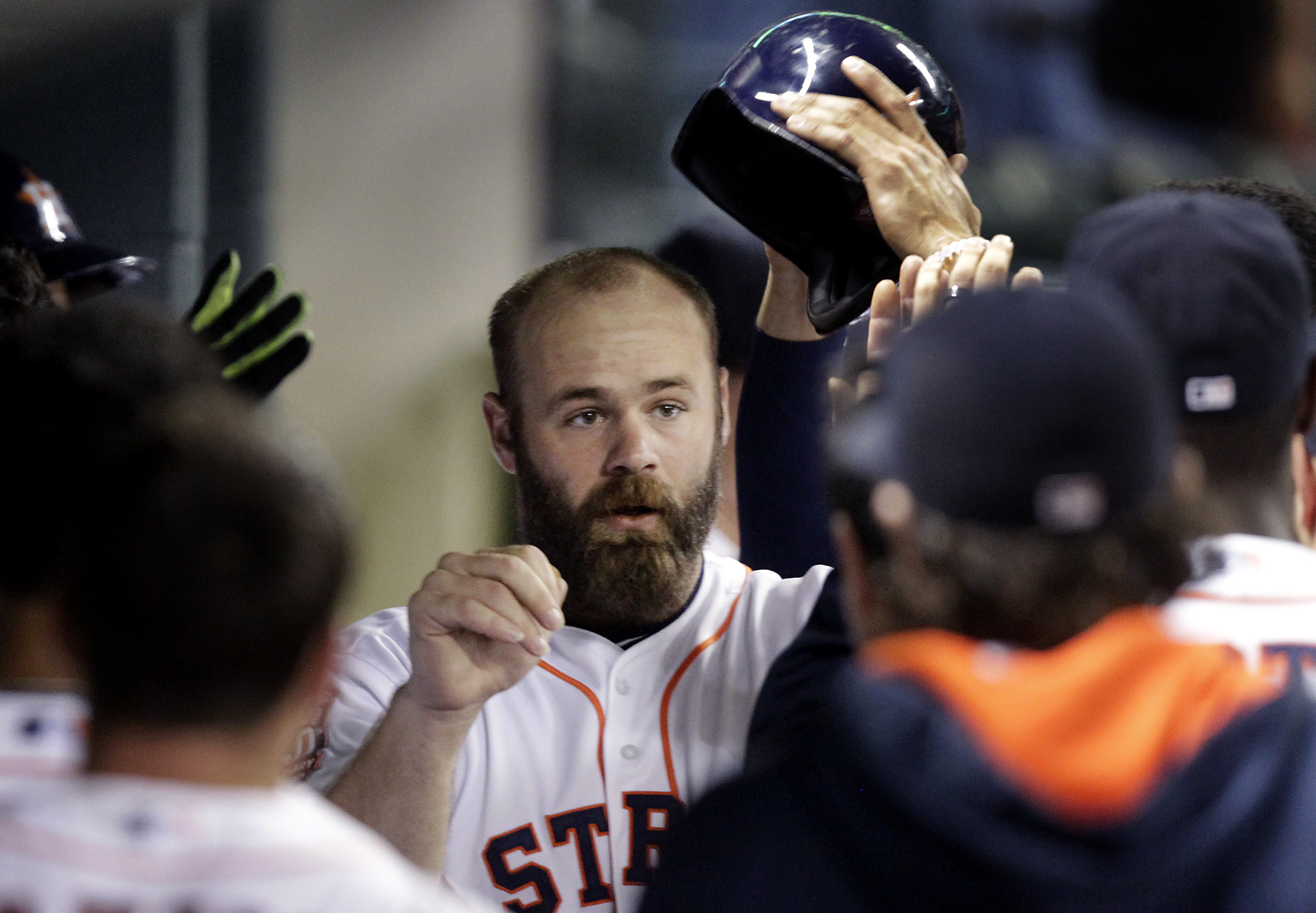 Houston Astros Evan Gattis is congratulated by teammates after hitting a home run during the fourth inning of a baseball game against the Tampa Bay Rays, Monday, August 17, 2015, in Houston. (AP Photo/Patric Schneider)