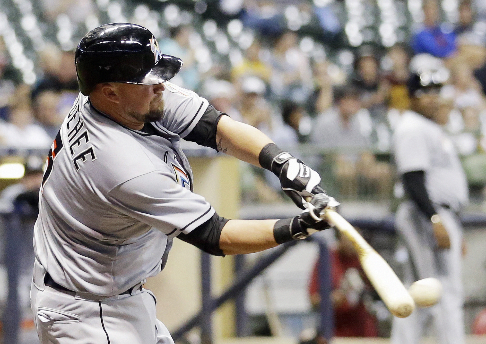 Miami Marlins' Casey McGehee hits an RBI single during the eighth inning of a baseball game against the Milwaukee Brewers Monday, Aug. 17, 2015, in Milwaukee. (AP Photo/Morry Gash)
