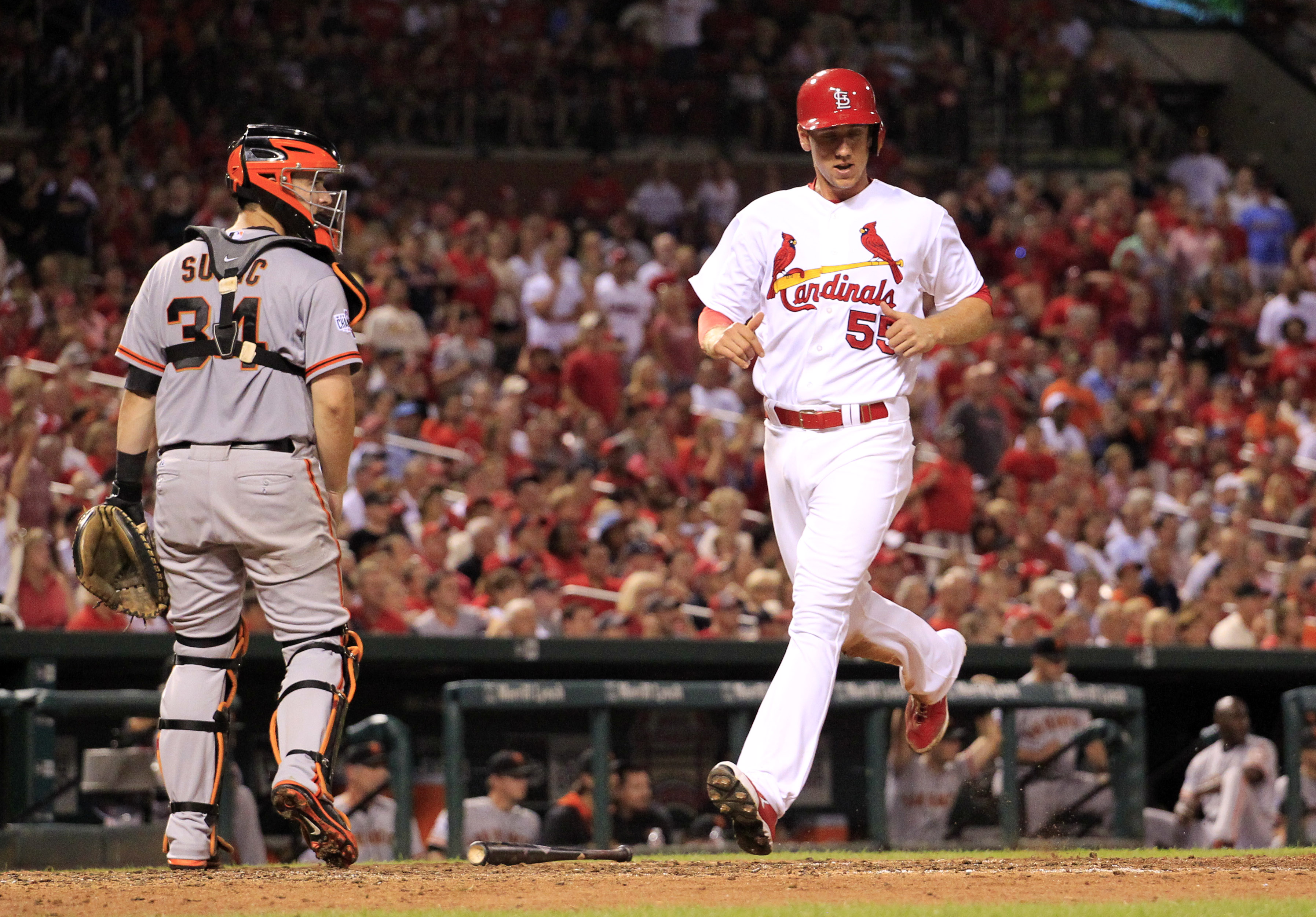 St. Louis Cardinals' Stephen Piscotty, right, scores past San Francisco Giants catcher Andrew Susac during the eighth inning of a baseball game Monday, Aug. 17, 2015, in St. Louis. (AP Photo/Jeff Roberson)