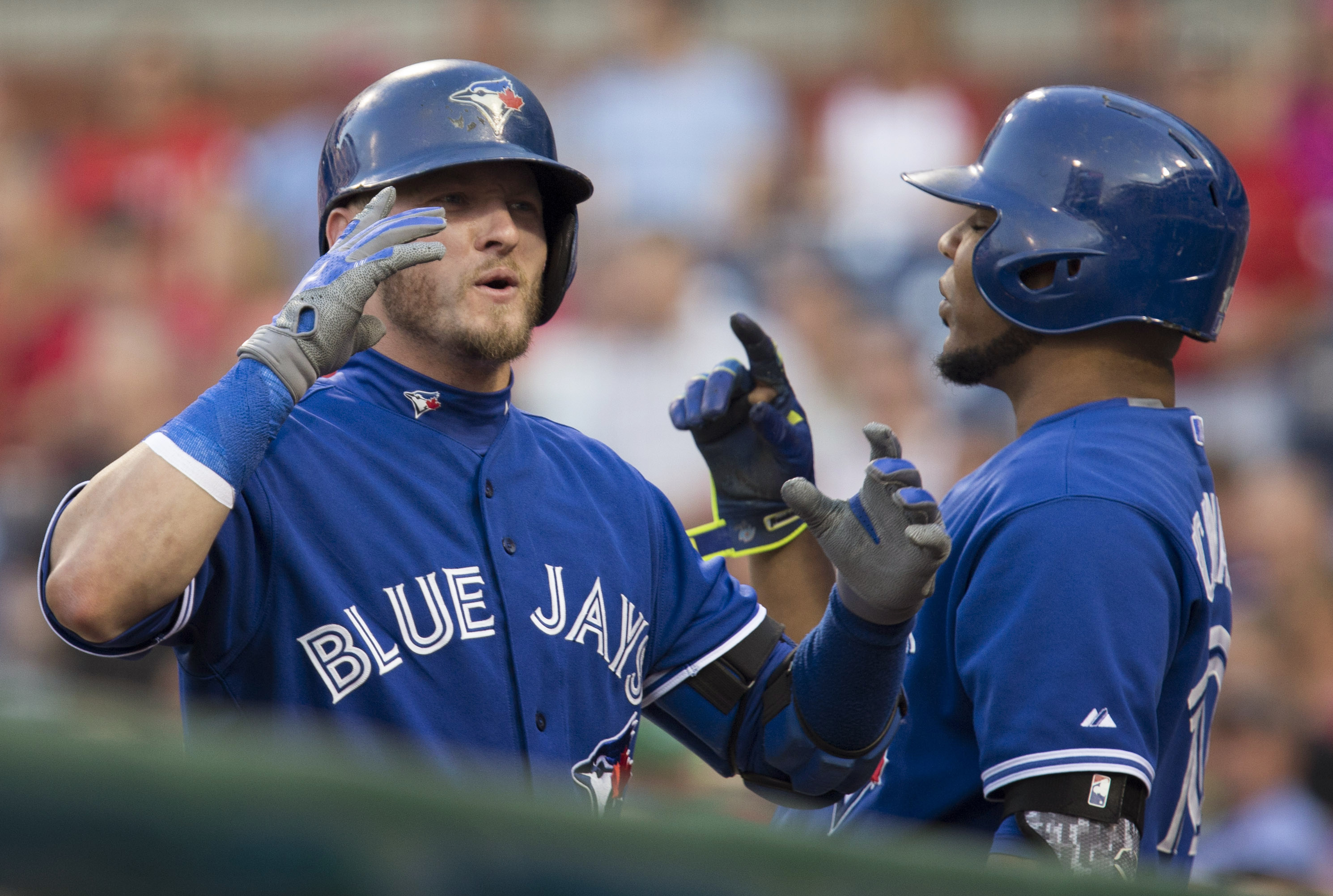 Toronto Blue Jays' Josh Donaldson, left, celebrates with Edwin Encarnacion after hitting a home run during the first inning of a baseball game against the Philadelphia Phillies, Tuesday, Aug. 18, 2015, in Philadelphia. (AP Photo/Laurence Kesterson)
