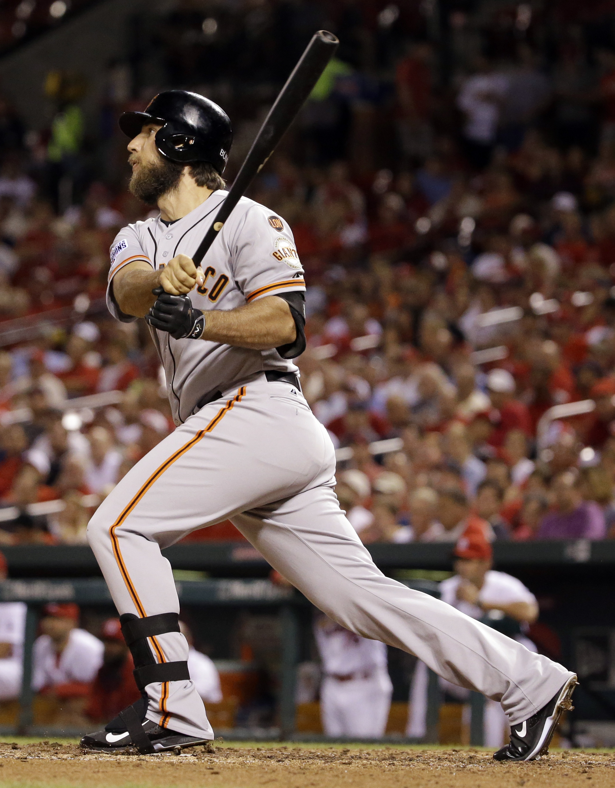 San Francisco Giants' Madison Bumgarner follows through on a single during the seventh inning of a baseball game against the St. Louis Cardinals, Tuesday, Aug. 18, 2015, in St. Louis. Bumgarner scored later in the inning. (AP Photo/Jeff Roberson)