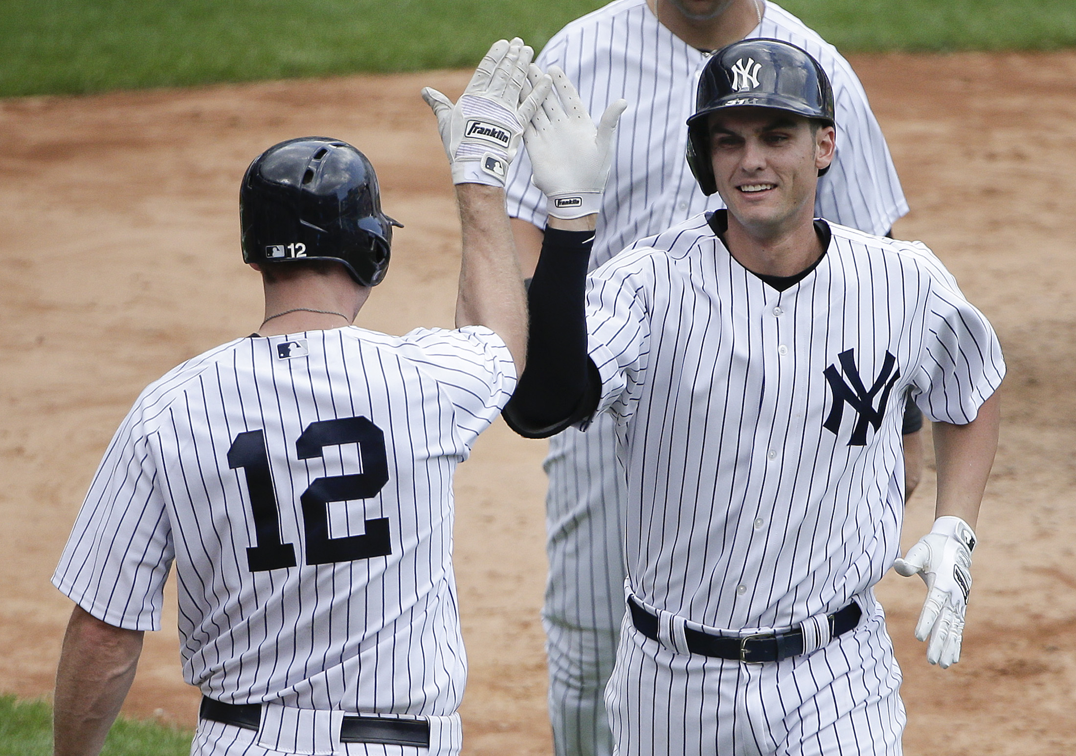 New York Yankees' Greg Bird, right, is greeted by Chase Headley (12) after hitting a two-run home run against the Minnesota Twins during the sixth inning of a baseball game, Wednesday, Aug. 19, 2015, in New York. It was his second two-run home run of the