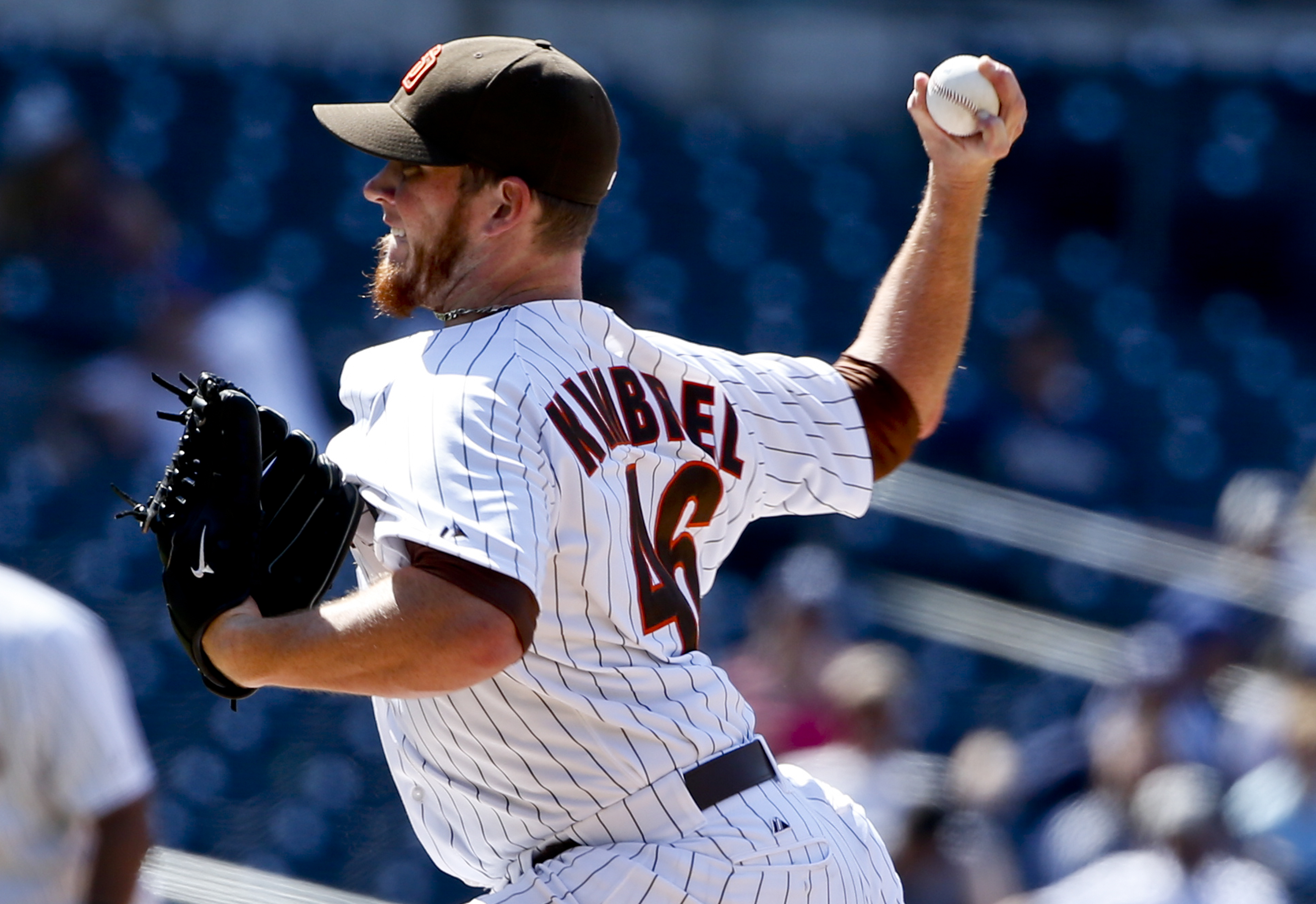 San Diego Padres closer Craig Kimbrel pitches while saving the Padres' 3-2 victory over the Atlanta Braves in a baseball game Wednesday, Aug. 19, 2015, in San Diego. (AP Photo/Lenny Ignelzi)
