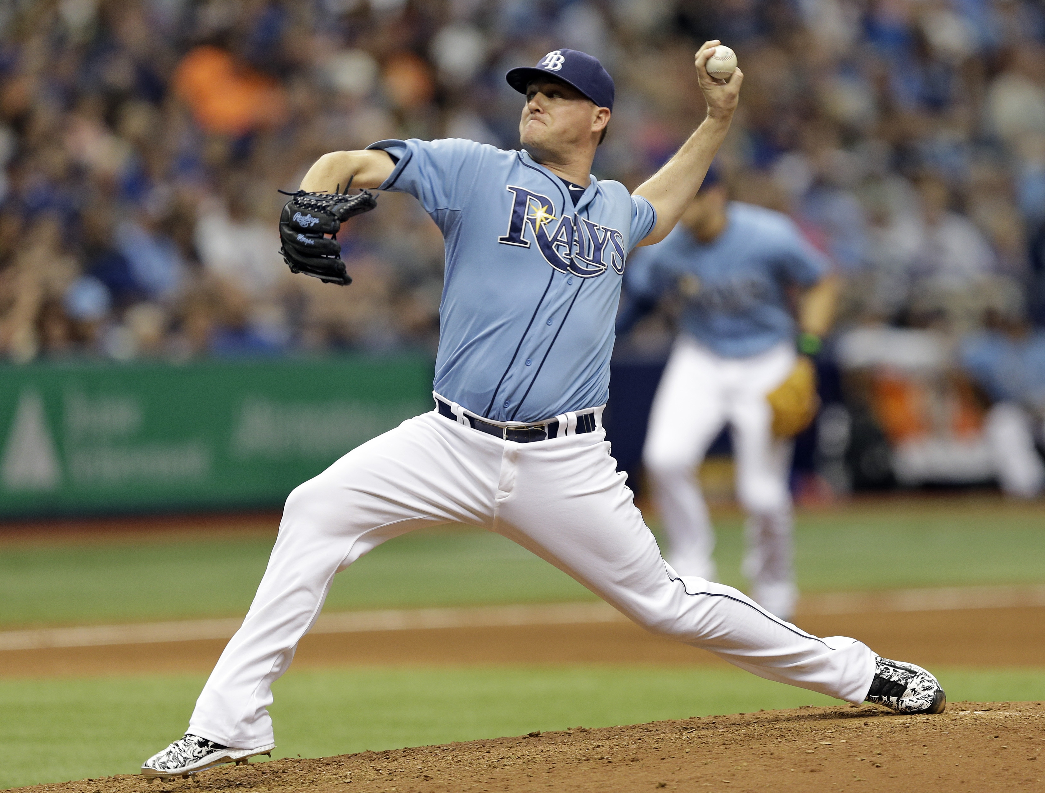 Tampa Bay Rays relief pitcher Jake McGee delivers to the New York Mets during the ninth inning of an interleague baseball game Sunday, Aug. 9, 2015, in St. Petersburg, Fla. McGee picked up the save in the Rays' 4-3 win. (AP Photo/Chris O'Meara)