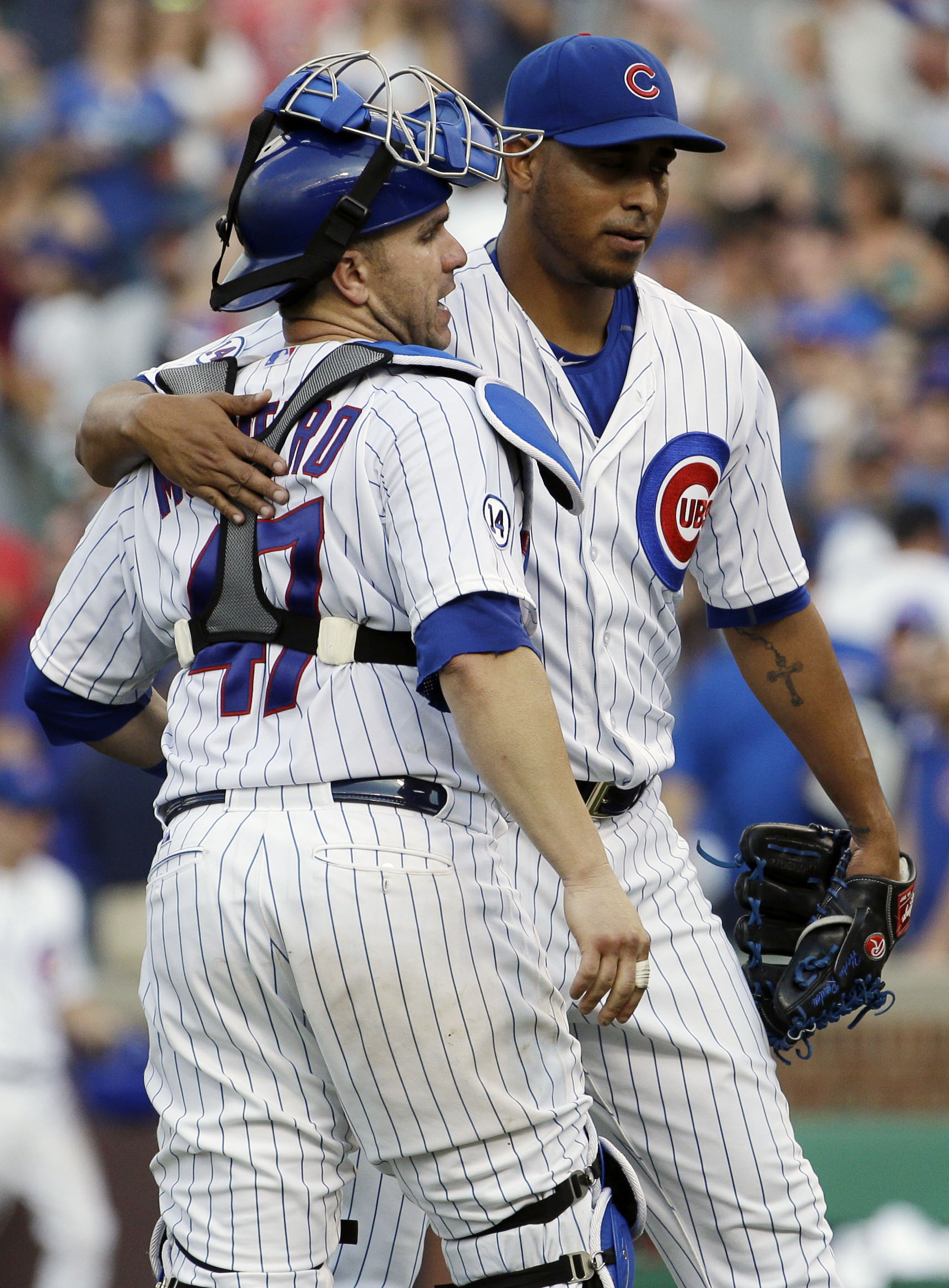 Chicago Cubs closer Hector Rondon, right, celebrates with catcher Miguel Montero after the Cubs defeated the Atlanta Braves 5-3 in a baseball game Friday, Aug. 21, 2015, in Chicago. (AP Photo/Nam Y. Huh)