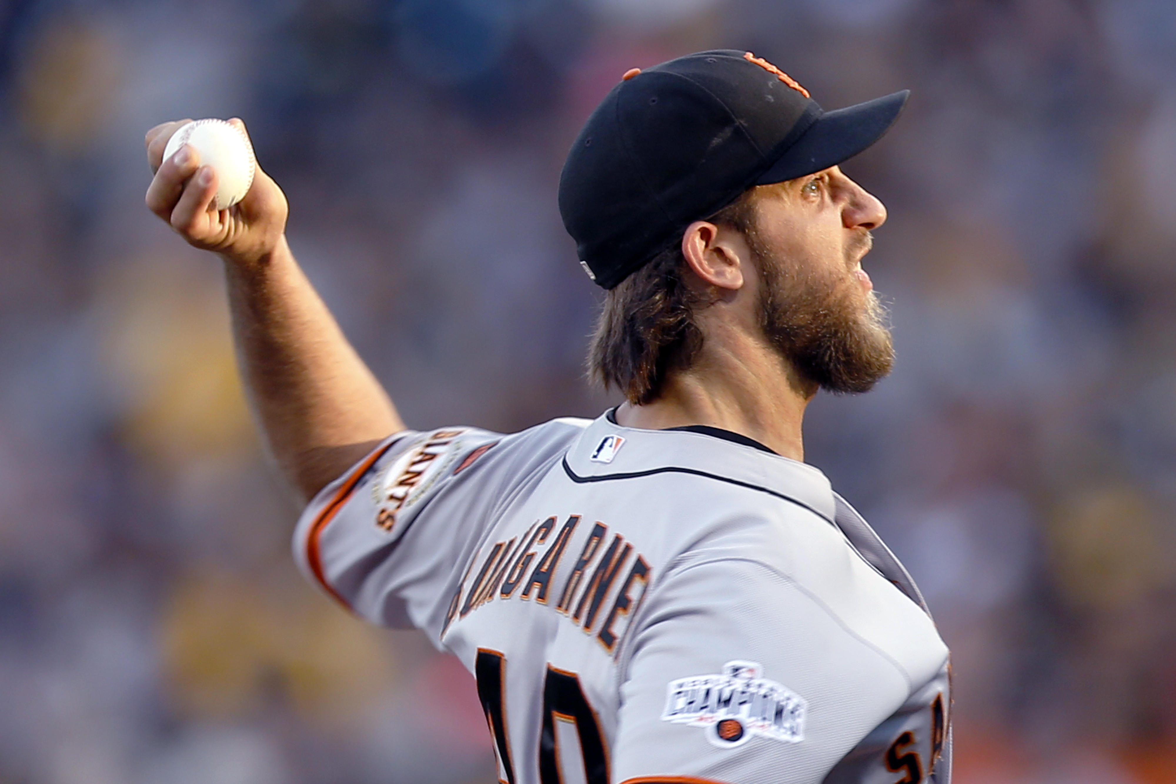 San Francisco Giants starting pitcher Madison Bumgarner throws against the Pittsburgh Pirates in the first inning of a baseball game, Friday, Aug. 21, 2015, in Pittsburgh. (AP Photo/Keith Srakocic)