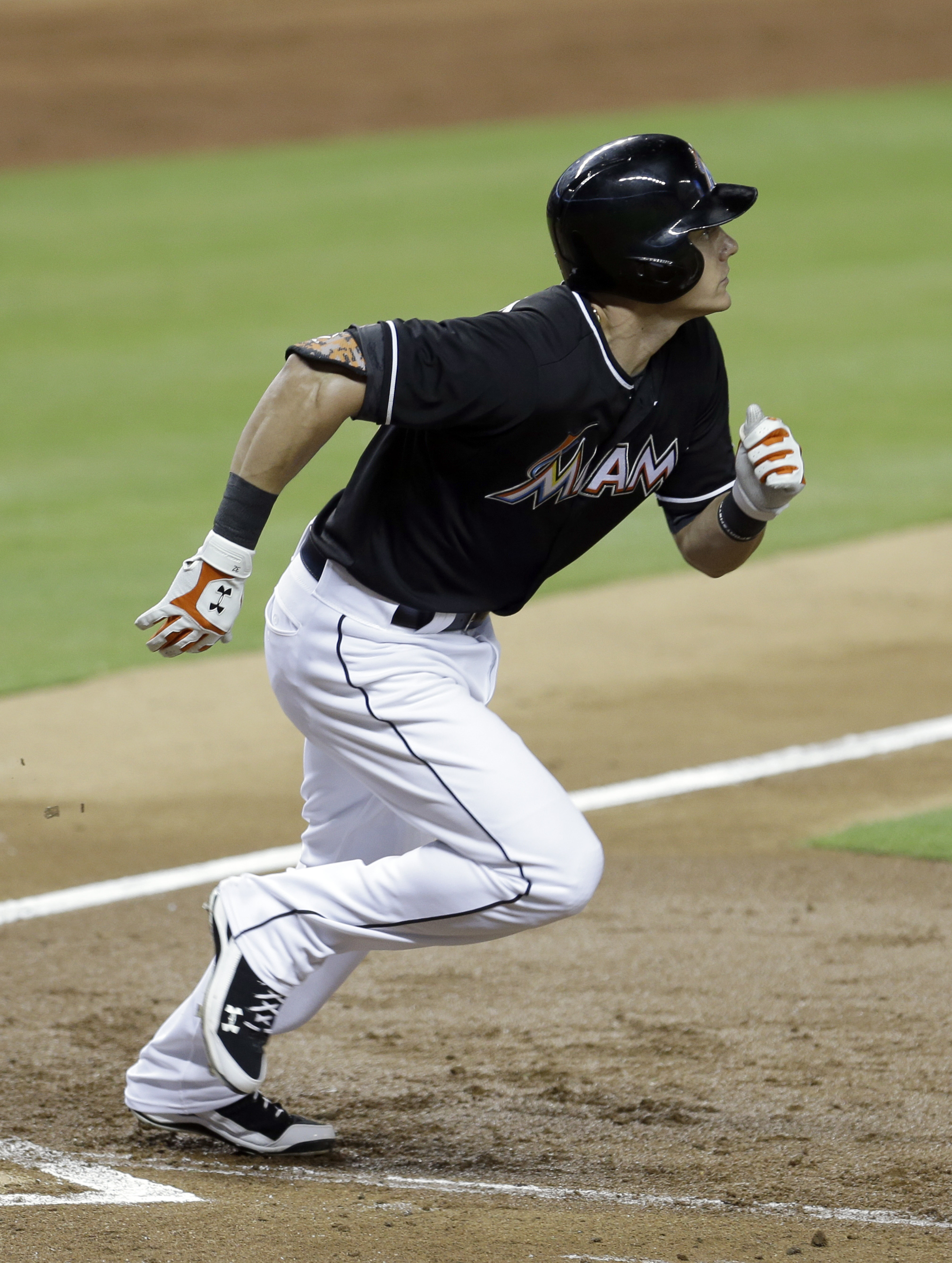 Miami Marlins' Derek Dietrich watches his two-run double against the Philadelphia Phillies during the third inning of a baseball game Saturday, Aug. 22, 2015, in Miami. (AP Photo/Alan Diaz)