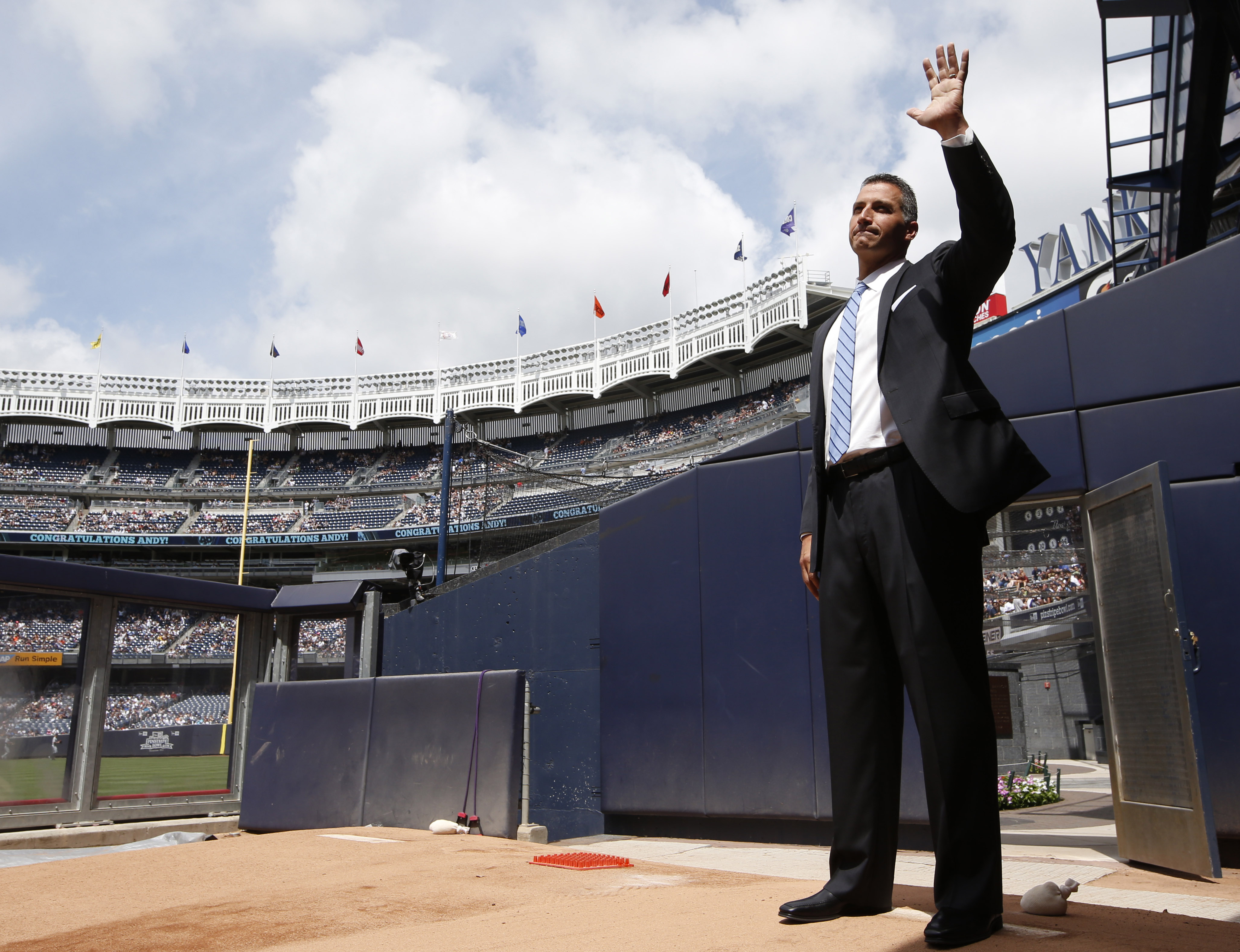Retired New York Yankees pitcher Andy Pettitte waves to the crowd from the bullpen as he is introduced in Yankee Stadium's Monument Park during a pregame ceremony retiring his number before a baseball game in New York, Sunday, Aug. 23, 2015.  The Yankees